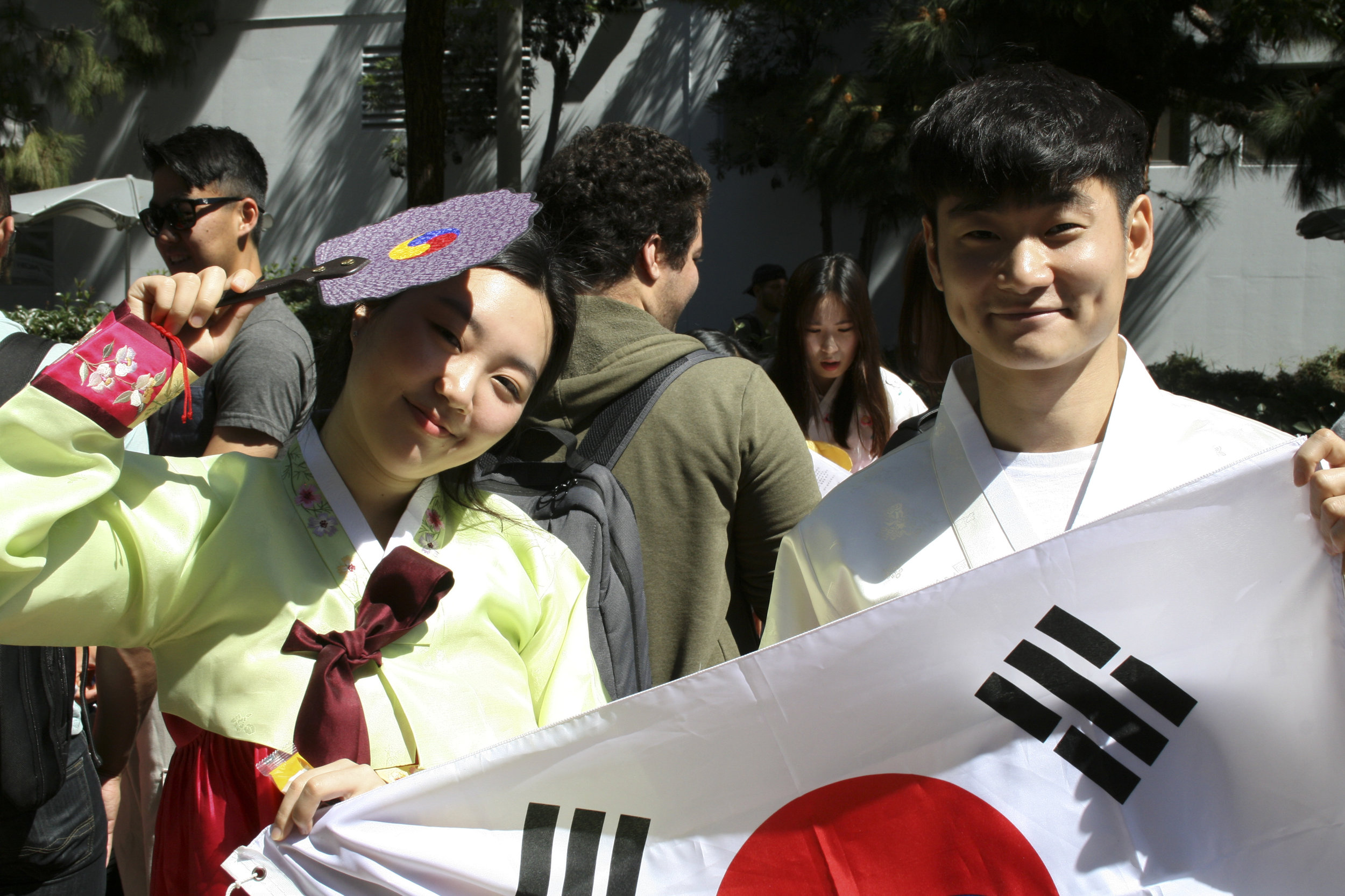 Yoori Kwak (Left) and Byeong-Heon Kim (Right) wear traditional South Korean clothing while holding their flag, promoting the Korean club. Club awareness day at main campus Santa Monica College, March 28, 2019. (Janet Ali/ The Corsair)