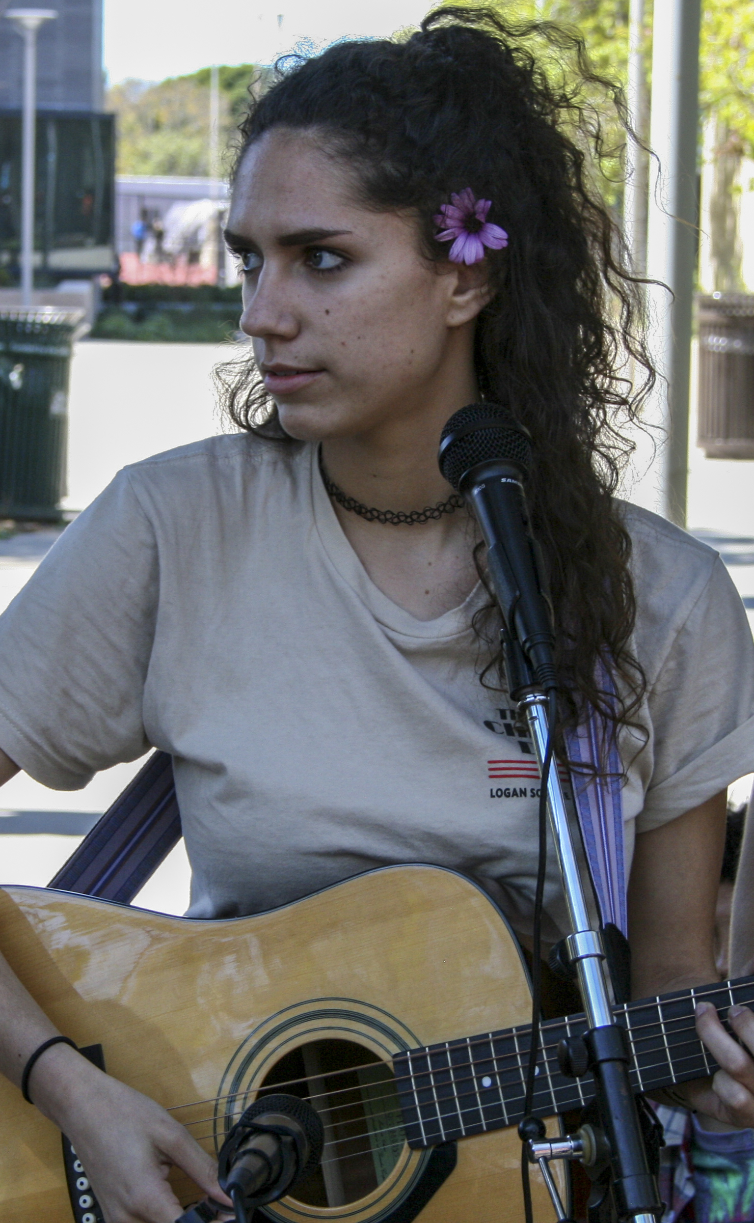Mariah Baxter member of the music club from Santa Monica College, sings and plays guitar during the club awareness day March 28, 2019. ( Janet Ali/ The Corsair)