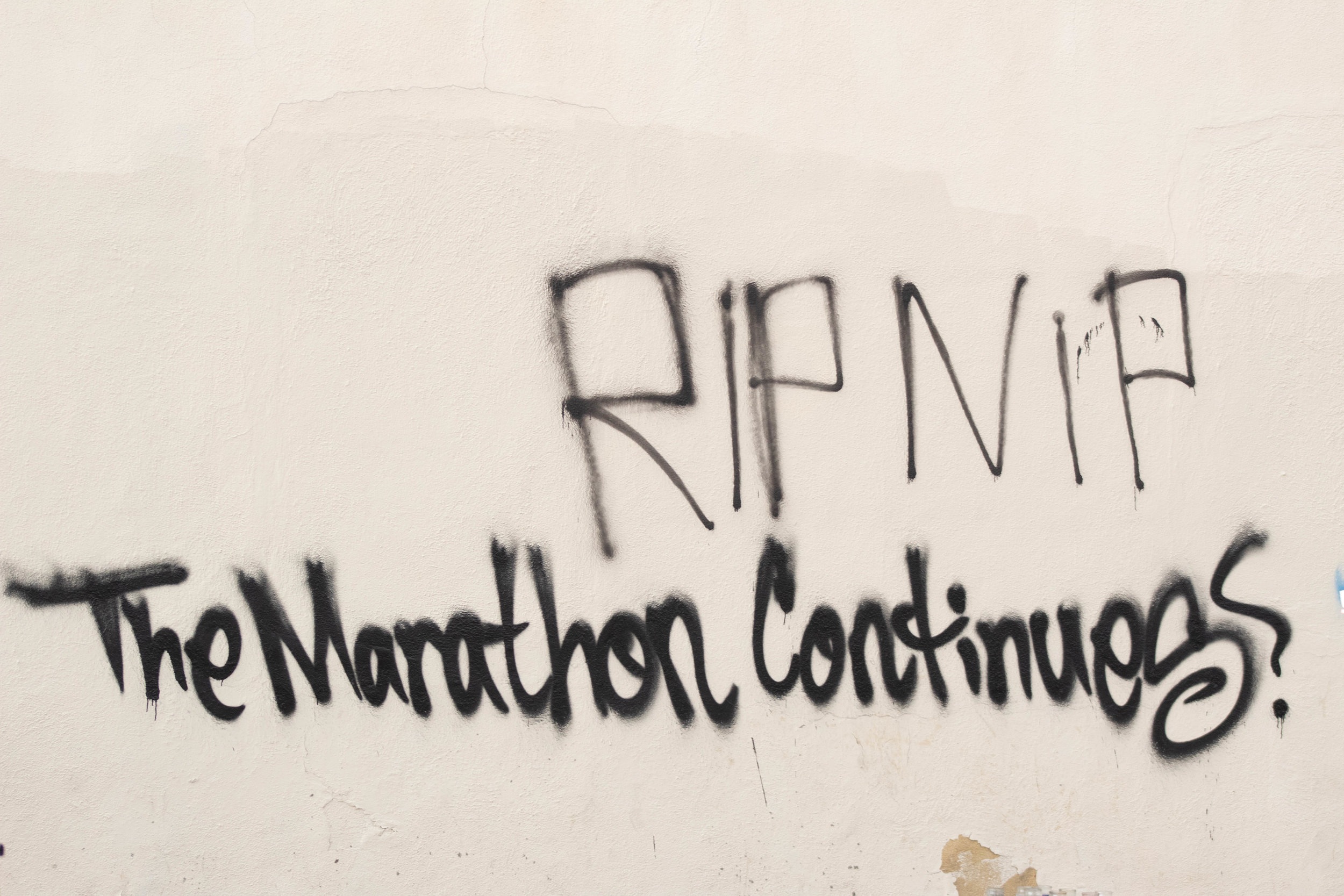 "Graffiti on a wall that reads: ""RIP Nip The Marathon Continues"" at the intersection of 57th Street and Crenshaw Boulevard in South Los Angeles, California on Thursday, April 11, 2019. ""The Marathon"" is the name of the store that the rapper Nipsey Hussle owned and was fatally shot in on Sunday, March 31, 2019 at the intersection of Crenshaw Boulevard and Slauson Avenue. (Catherine Lima/Corsair Staff)"
