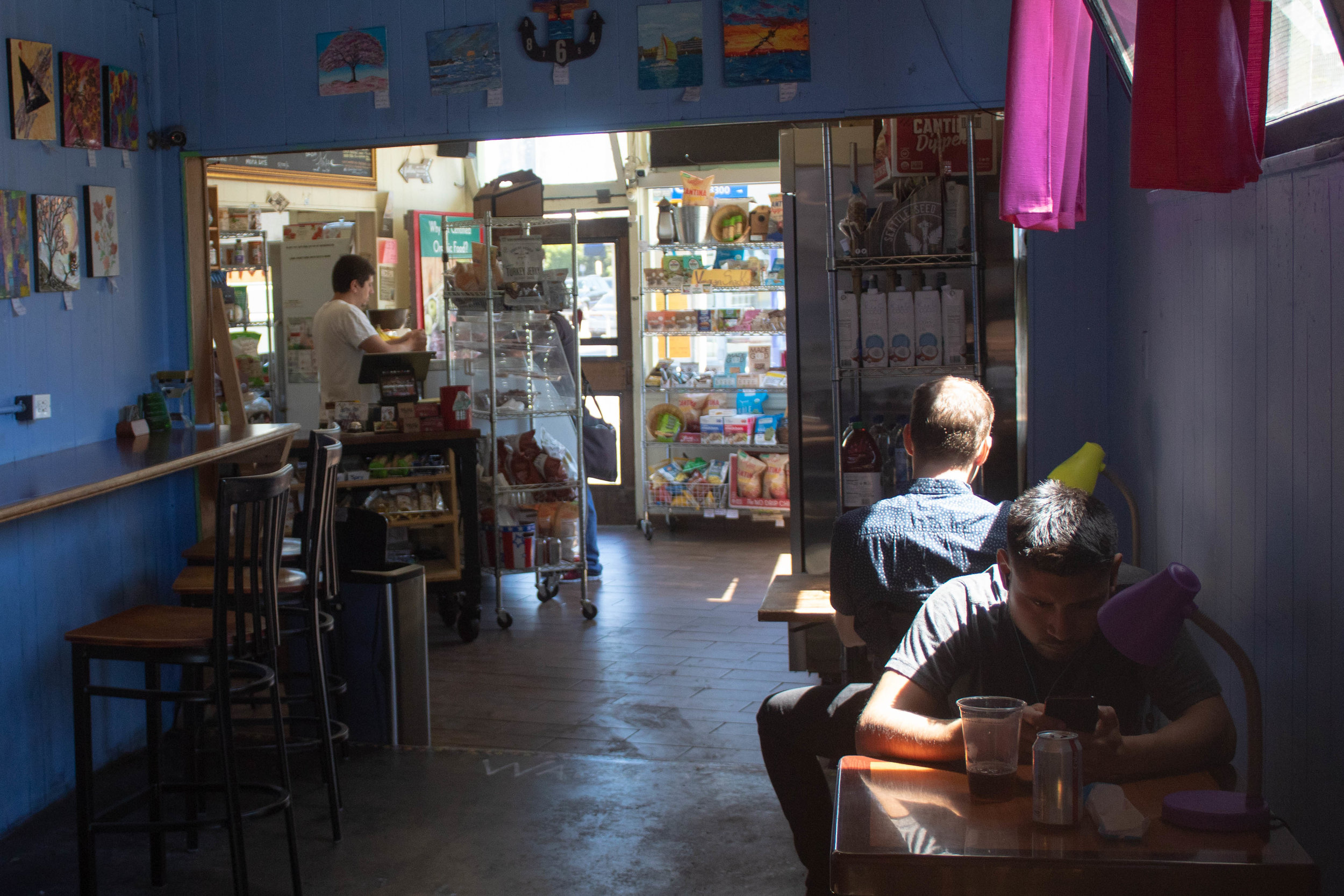 At around 2:30 in the afternoon, UnUrban Coffee House is nearly empty and mostly quiet if not for the white noise of cars breezing down Pico Blvd in Santa Monica, California on