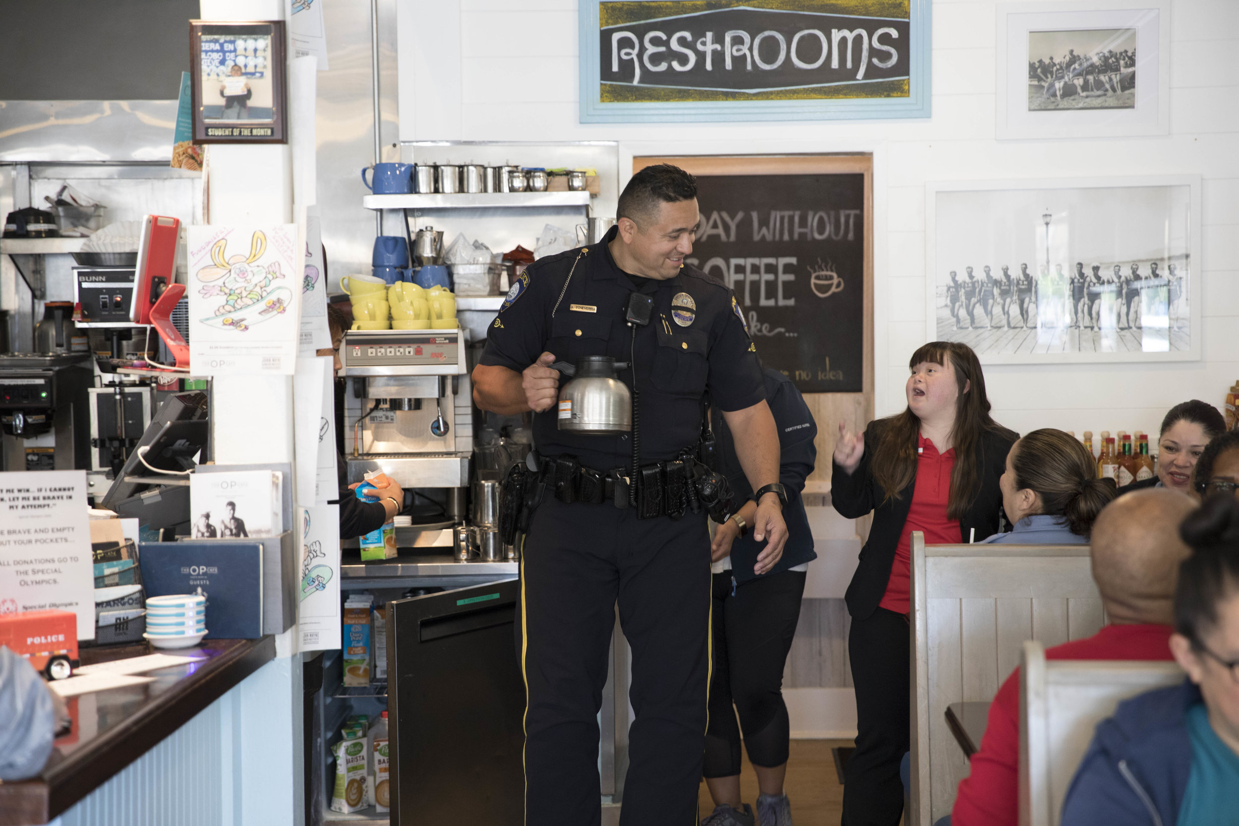 Santa Monica College Police Officer Albert Echeverria, serving breakfast to customers at The Santa Monica College Police Department fundraiser for the Southern California Special Olympics at The OP Cafe on Tuesday April 23, 2019. This fundraiser is to help raise money for a campaign called Law Enforcement Torch Run, to benefit the Special Olympics. (Tanya Barcessat / The Corsair)