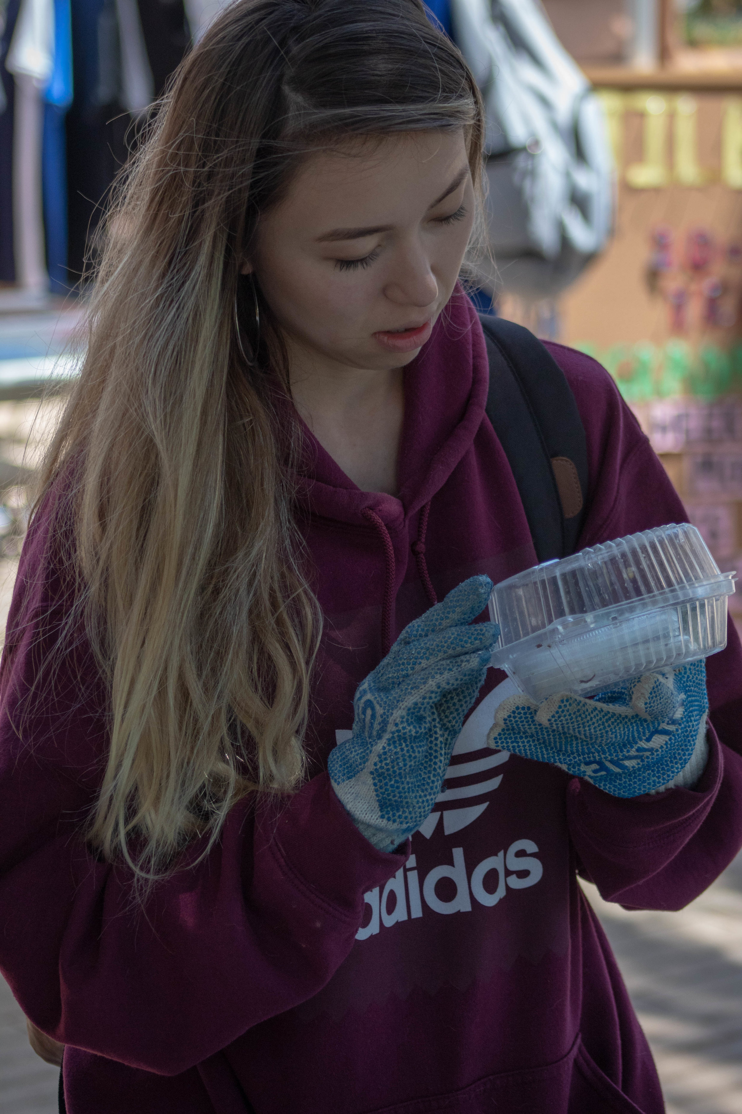 Zulfinarr Kunanba, a Business student at Santa Monica College, participates in the Trash Sorting Game during the Earth Week Interactive Learning Day at the SMC main campus quad on Wednesday, April 24, 2019 in Santa Monica, California. (Catherine Lima/Corsair Staff)
