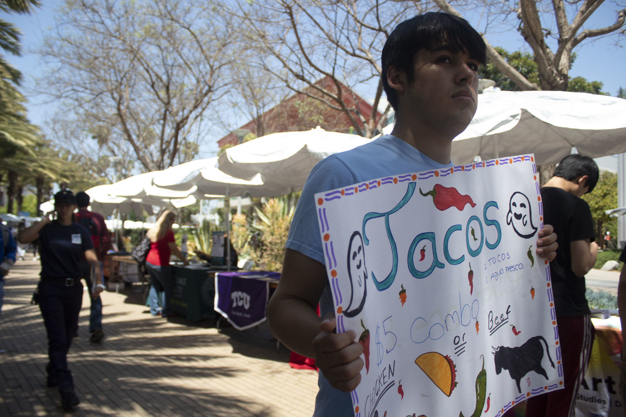A student advertises Tacos on campus for his booth during the Santa Monica College (SMC) College Fair. April 23, 2019. (Pablo Eden Garcia/ The Corsair)
