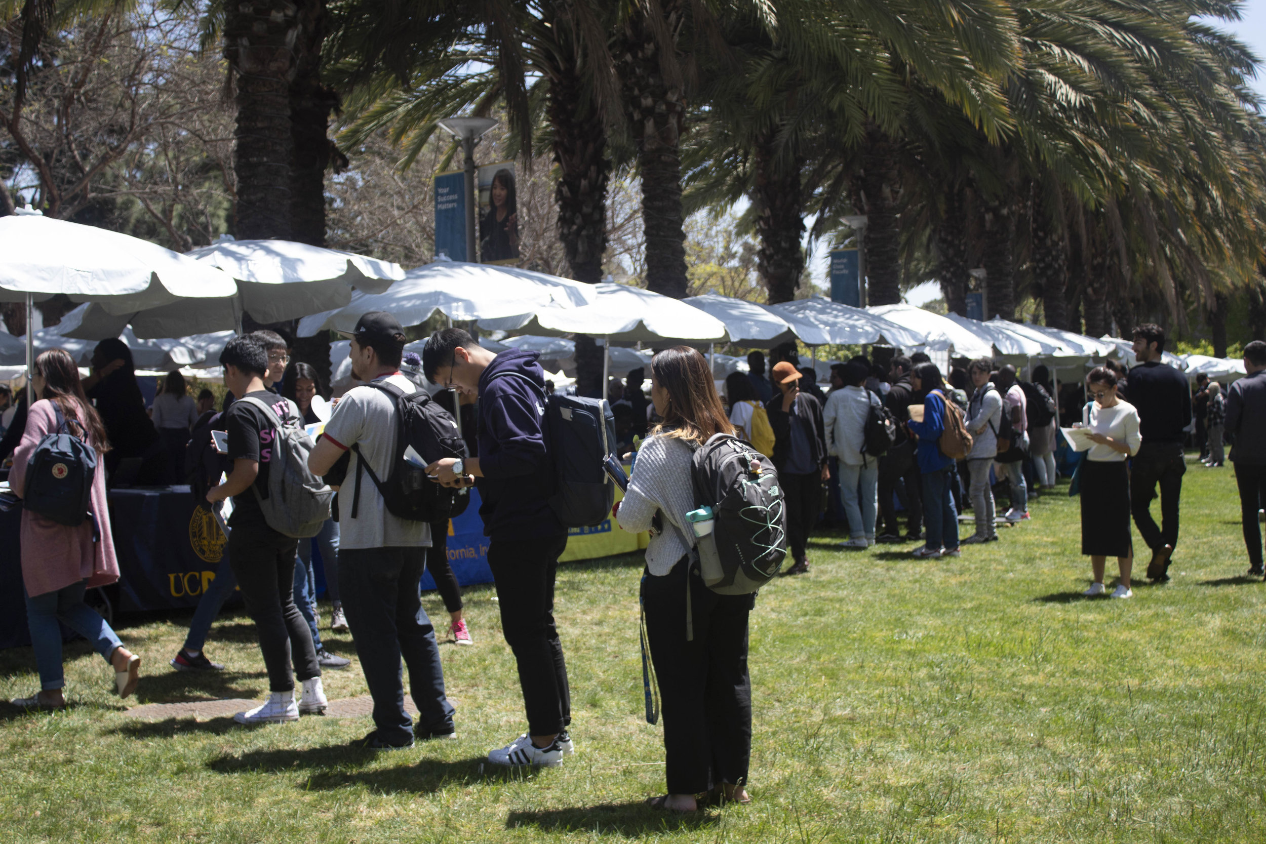 Students of Santa Monica College line up for the Universities of California (UC) booths. April 23, 2019. (Pablo Eden Garcia/ The Corsair)