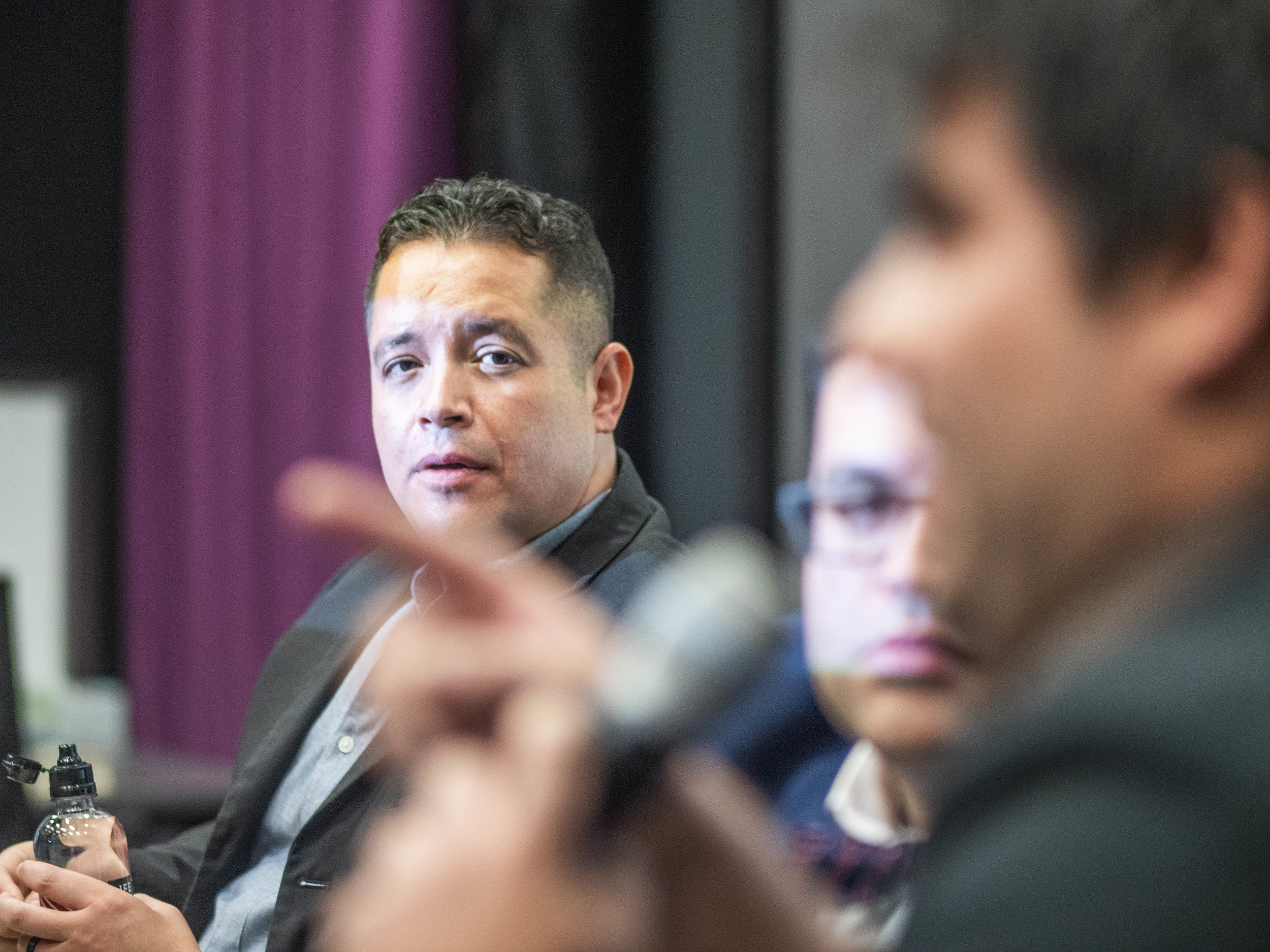 "Santa Monica College (SMC) student and Producer Dennis Sandovol listens to Writer Director Oswaldo Ozuna after the screening of ""Muñecas,"" on Tuesday, May 7, 2019 at the SMC Center for Media Design. Rengifo is a Rotten Tomatoes Certified Film Reviewer and former SMC student and Sandovol is currently taking a Cinematography class at SMC and says ""I'm learning a lot in it, it's great."" ""Muñecas"" won the Best Student Film Award at the 2017 Prague Independent Film Festival in 2017. Santa Monica, California. (Victor Noerdlinger/Corsair)"