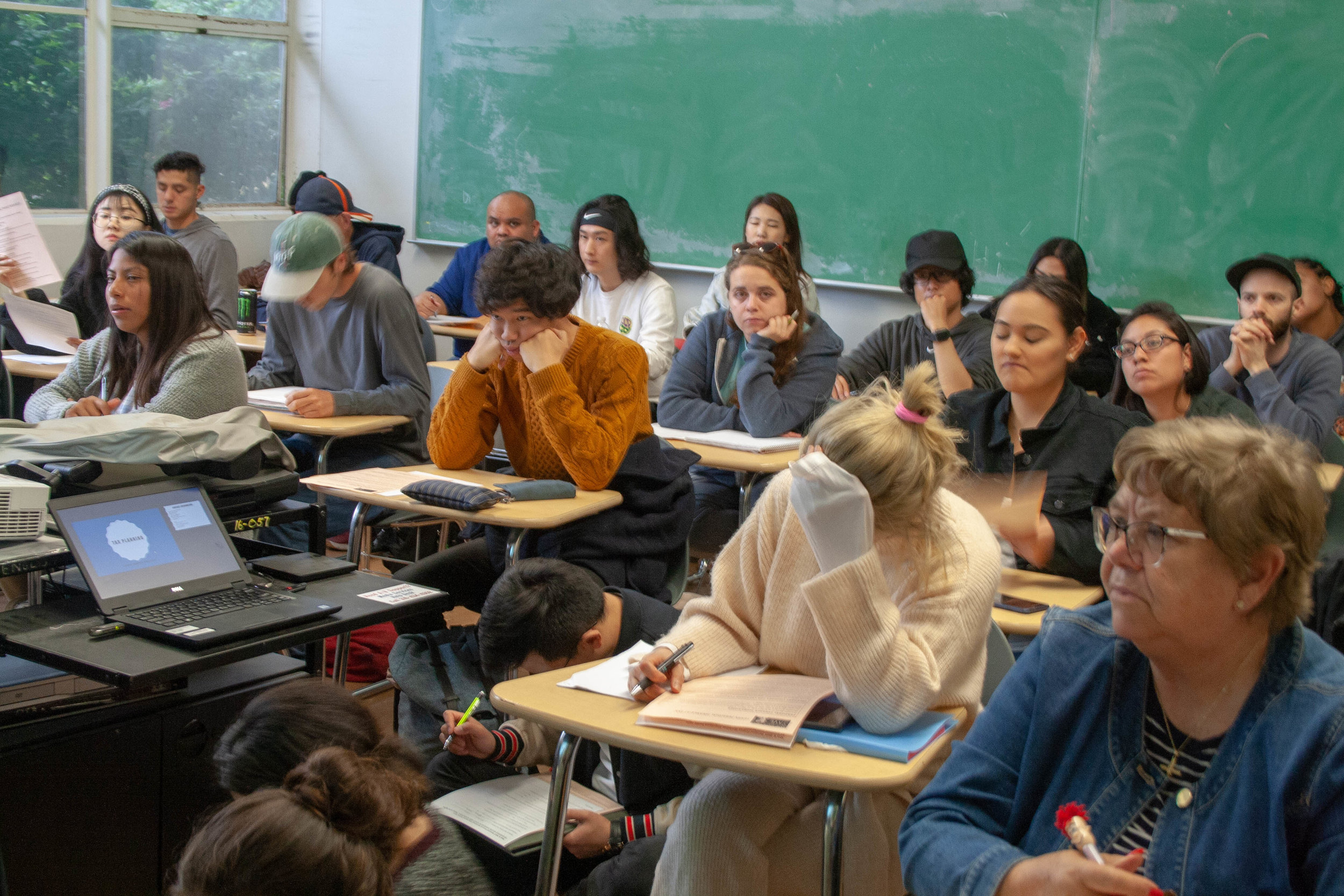 Students from Santa Monica College sit in a small classroom located in the L.A building at main campus Santa Monica College on May 9th, 2019 to listen to a finance workshop hosted by Jenny Resnick and Cesar Rubio in Santa Monica, California. (The Corsair/ Janet Ali)