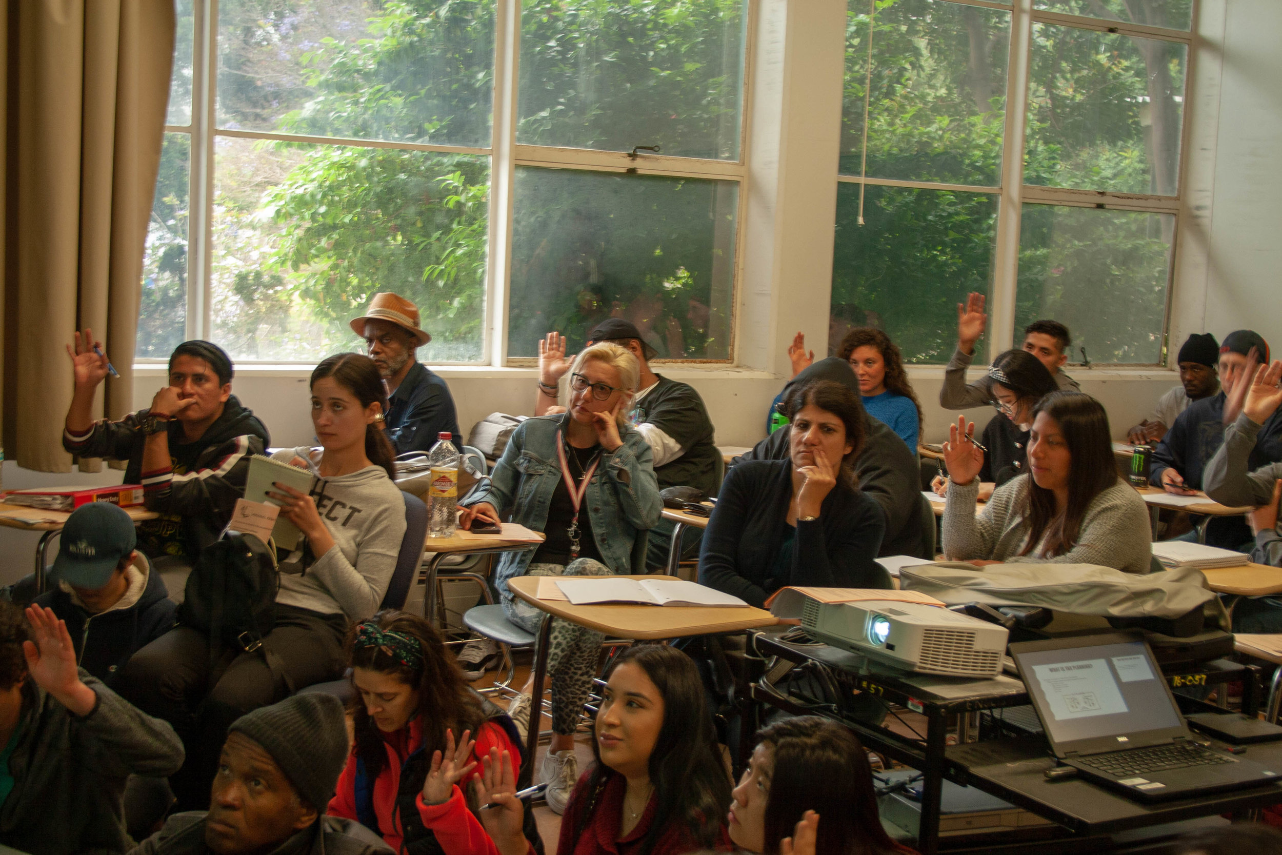 Santa Monica College students raise their hands when asked if they file their taxes, students that are from all ages join the financial workshop hosted by Jenny Resnick on May 9th, 2019 in Santa Monica College, Santa Monica California. (The Corsair/ Janet Ali)