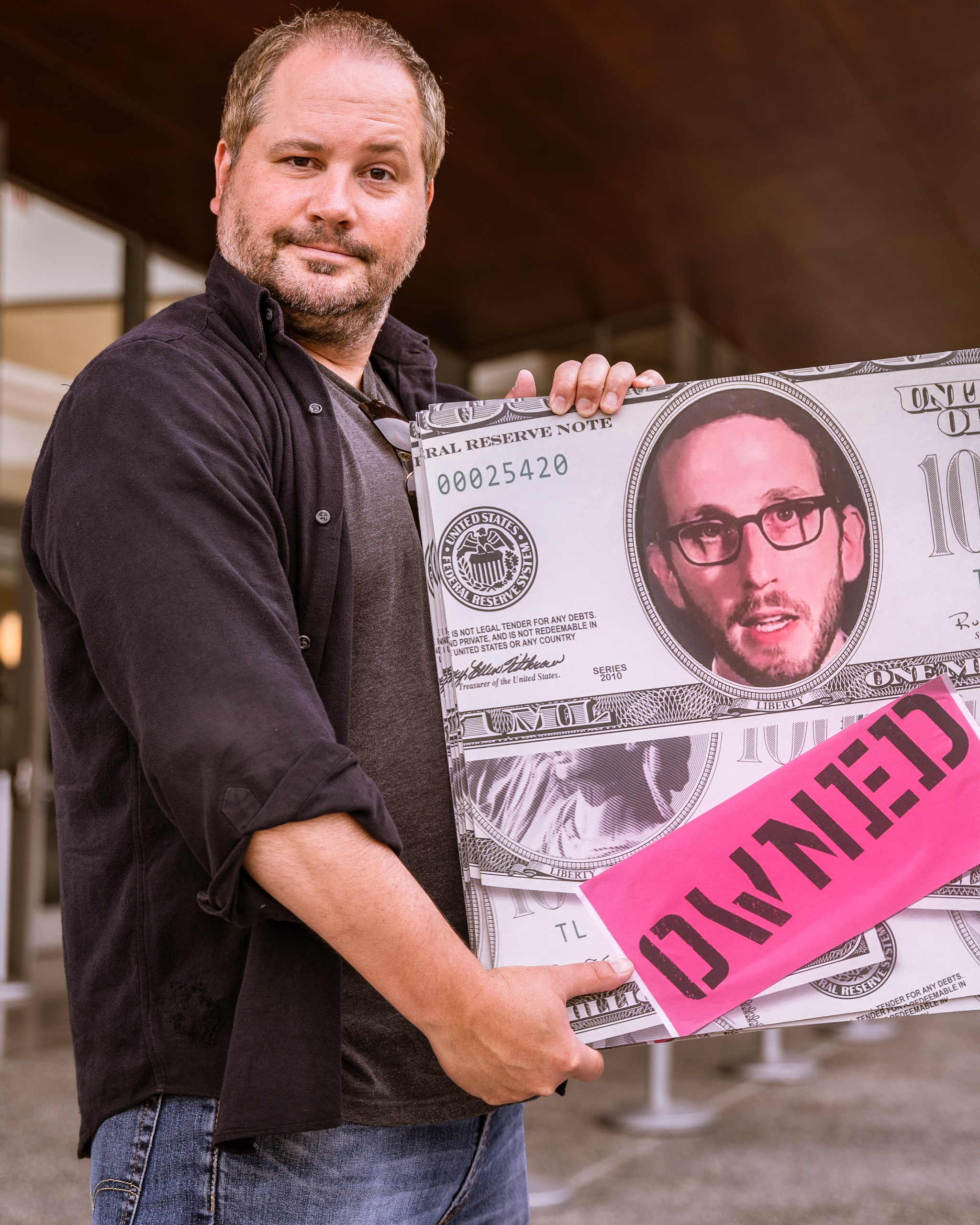 """Lawyer and journalist Chris Legras of Santa Monica holds a sign questioning the motives of California State Senator Scott Weiner's (SD11 – San Francisco) SB 50 which proposes new approaches to California's housing issues, outside the the Broad Stage at the SMC Performing Arts Center on Thursday, May 9, 2019. Legras said, """"I worry about SB-50, it's a poorly planned, rushed solution to a problem we all know exists. It's going to effect the poor and marginalized the most."""" The SMC Public Policy Institute is presenting its 8th Annual Spring Symposium, """"There Goes the Neighborhood, Part II: How might policy approaches prevent displacement in neighborhoods affected by gentrification?"""" from May 4-9. Tonight's final event in the series is """"Where Goes the Road to Solving California's Housing Crisis? A Keynote Discussion with Legislative Leaders."""" The panel includes California state legislators Senator Ben Allen (SD26 – Santa Monica) and Senator Scott Weiner (SD11 – San Francisco), author of SB 50 which proposes bold approaches to California's housing issues, and Santa Monica Mayor Gleam Davis, a former Co-Chair of Santa Monicans for Renters' Rights and leading advocate for Santa Monica's innovative policy solutions and funding for affordable housing."""" (Glenn Zucman/The Corsair)"""