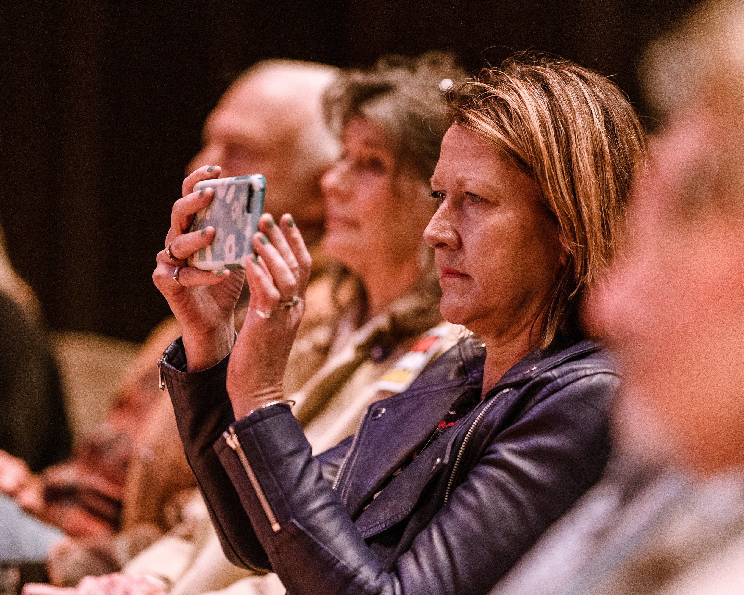 """Lesley O'Toole from Hollywood, by way of Hampshire, England, sits in the front row and documents the discussion on the California Housing Crisis at the SMC Broad Stage on Thursday, May 9, 2019. O'Toole said she was attending tonight because, """"I want to try to save my neighborhood from destruction."""" The SMC Public Policy Institute is presenting its 8th Annual Spring Symposium, """"There Goes the Neighborhood, Part II: How might policy approaches prevent displacement in neighborhoods affected by gentrification?"""" from May 4-9. Tonight's final event in the series is """"Where Goes the Road to Solving California's Housing Crisis? A Keynote Discussion with Legislative Leaders."""" The panel includes California state legislators Senator Ben Allen (SD26 – Santa Monica) and Senator Scott Weiner (SD11 – San Francisco), author of SB 50 which proposes bold approaches to California's housing issues, and Santa Monica Mayor Gleam Davis, a former Co-Chair of Santa Monicans for Renters' Rights and leading advocate for Santa Monica's innovative policy solutions and funding for affordable housing."""" (Glenn Zucman/The Corsair)"""