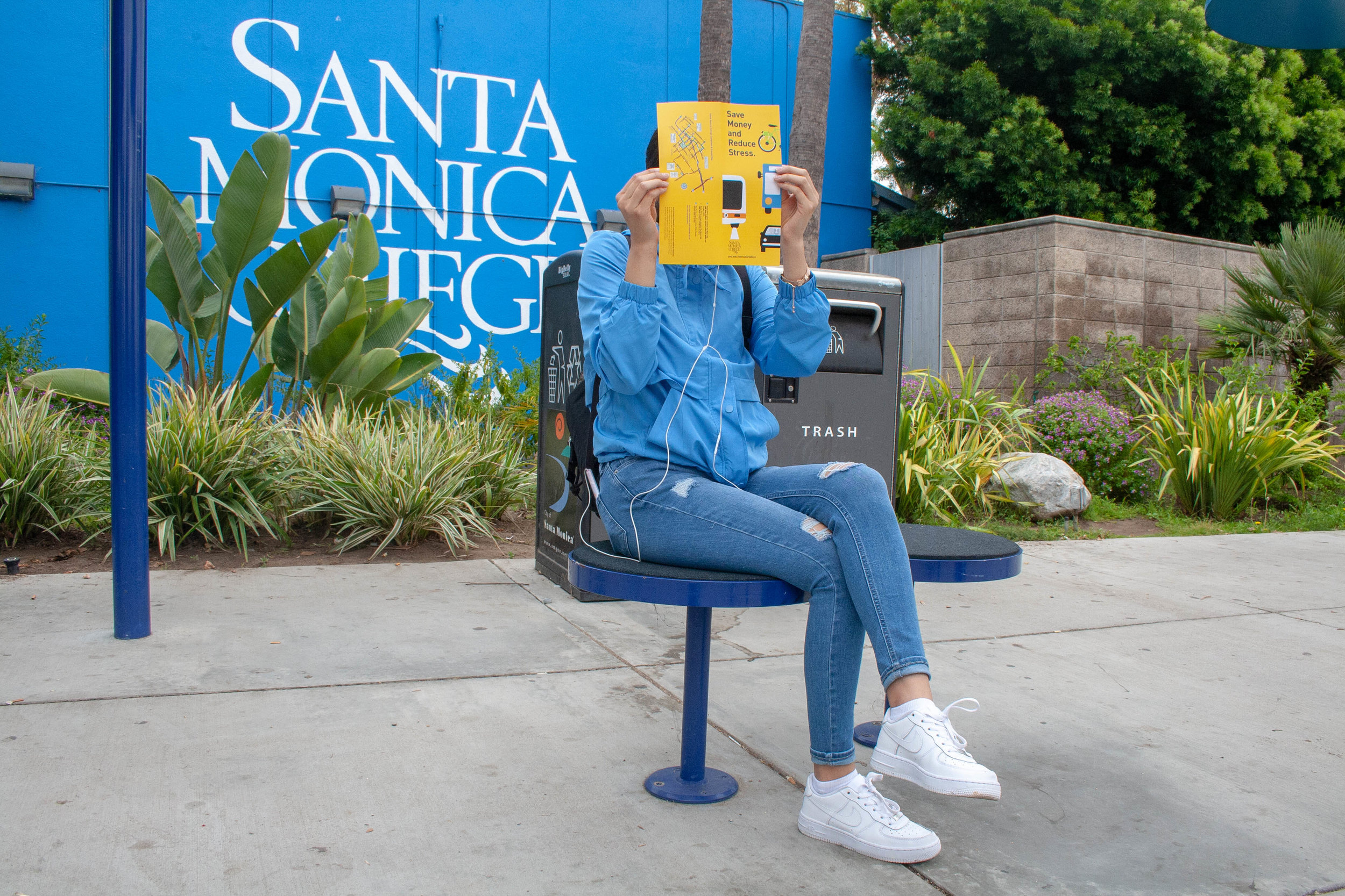 Public transportation has always been convenient because its price, speed and practicality but in some cases students face sexual harassment and those cases stay in the closet. Student poses with a pamphlet to cover her identity. Santa Monica College, Santa Monica, California. May 14, 2019. (The Corsair/ Janet Ali)