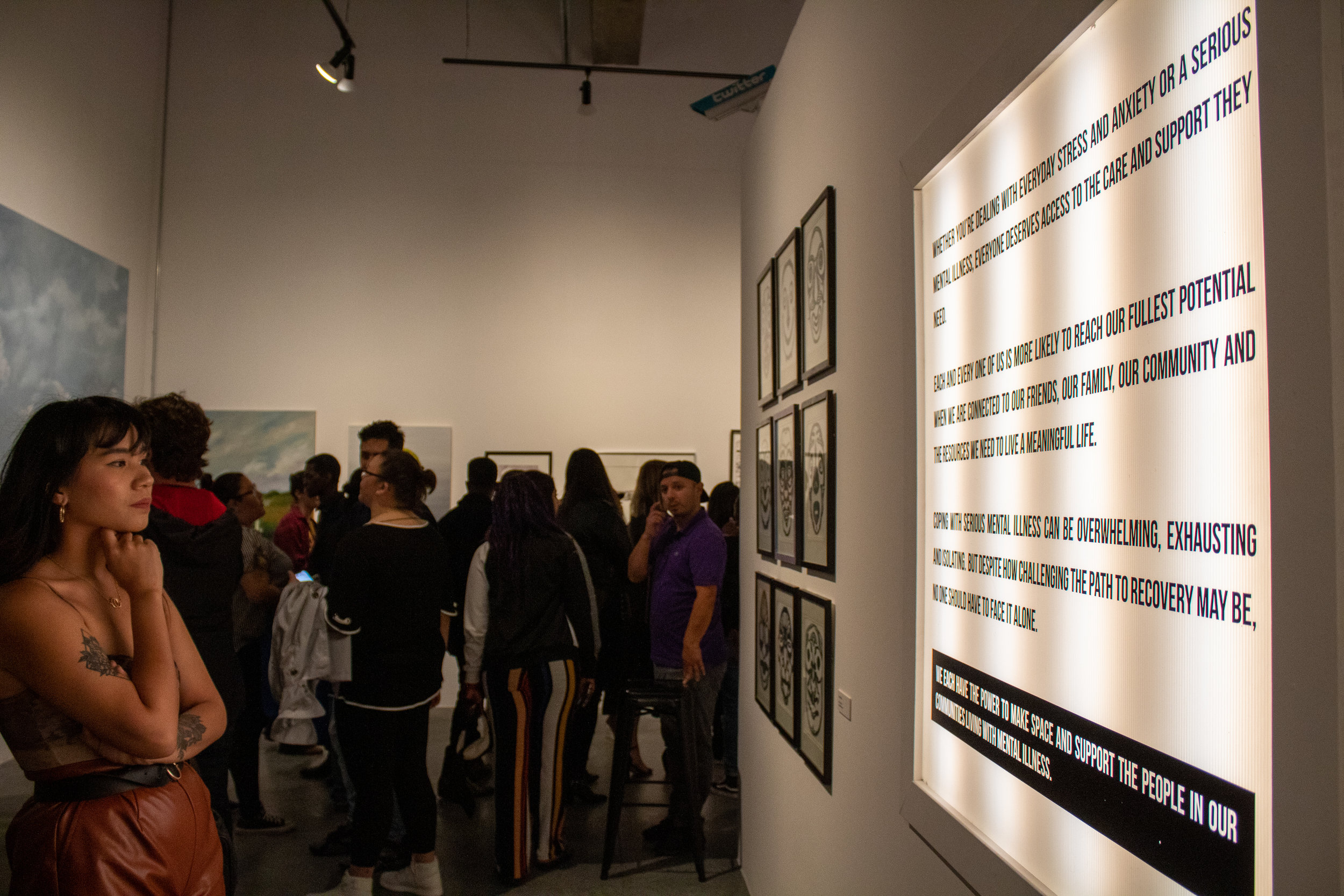 Attendees observe the exhibitions that fill the gallery space of We Rise LA on May 17, 2019. We Rise is a pop-up immersive art gallery and community space in Los Angeles, California, focused on themes of Connectedness and Purpose, aiming to engage with the public through the arts. Danica Creahan / The Corsair