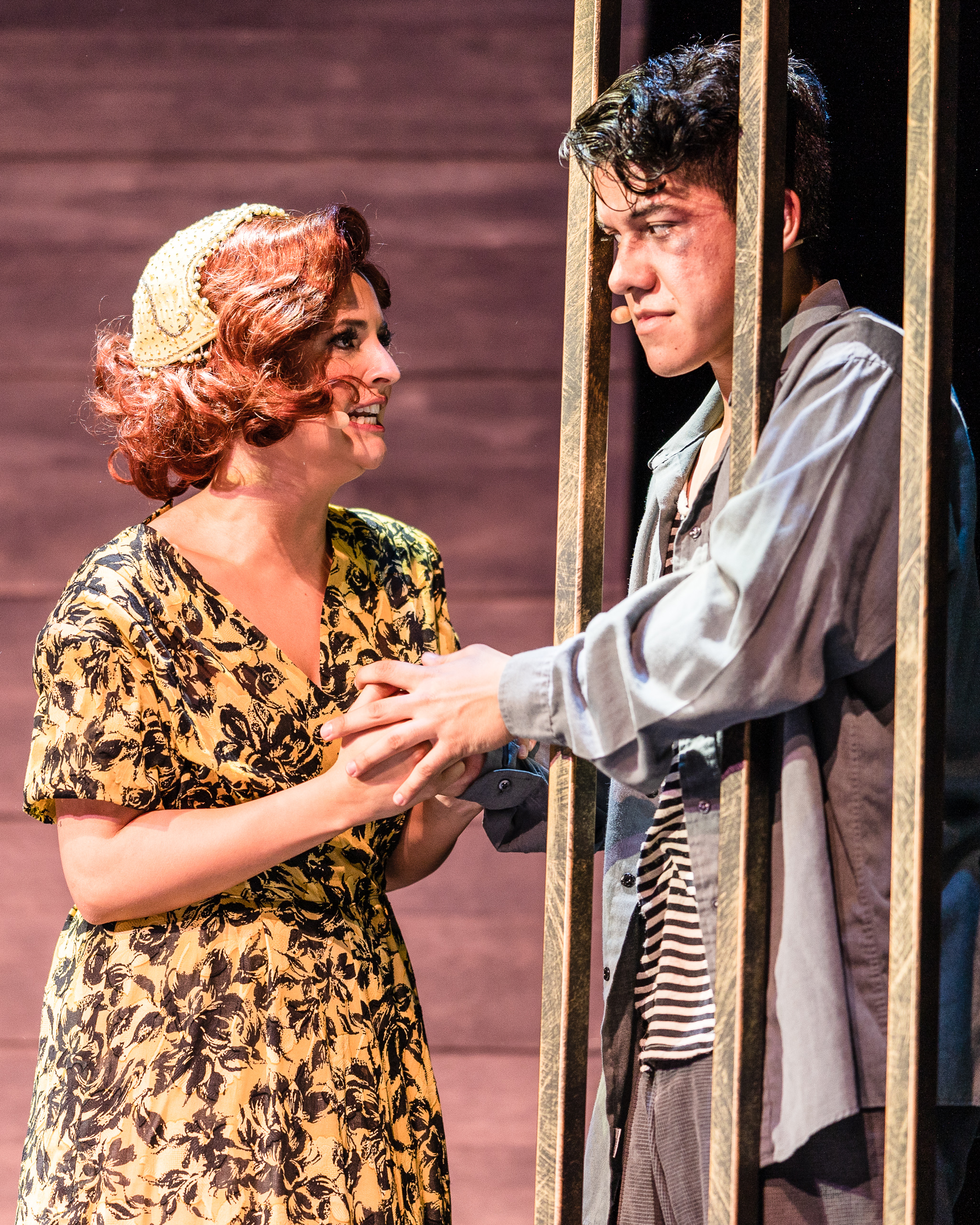 Val Castano (Bonnie Parker) a communications and music major from Miami, FL visits a beaten Joseph Martinez (Clyde Barrow) a theatre major from Lancaster, CA, in prison during the dress rehearsal for the SMC production of Bonnie and Clyde on the SMC Main Stage on Tuesday, May 21, 2019. (Glenn Zucman/The Corsair)