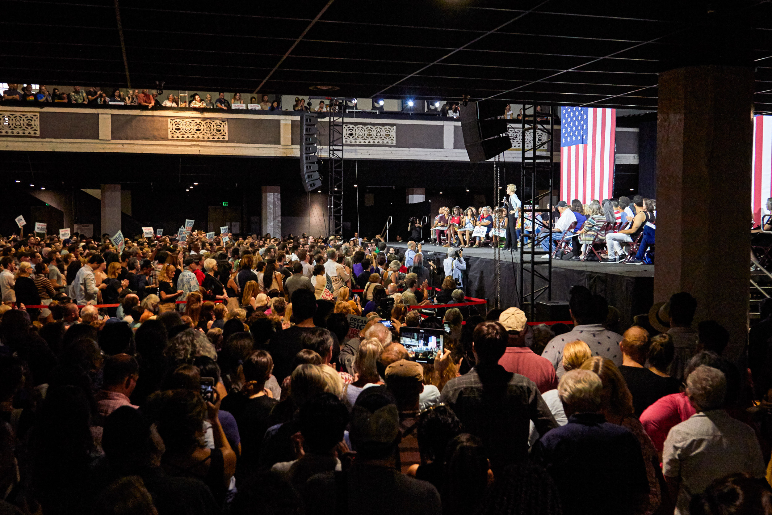 People in the audience listen to Massachusetts senator Elizabeth Warren speaking at a Town Hall event for her presidential campaign, at the Shrine Expo Hall, Los Angeles, California, on August 21st 2019. (Marco Pallotti/The Corsair)