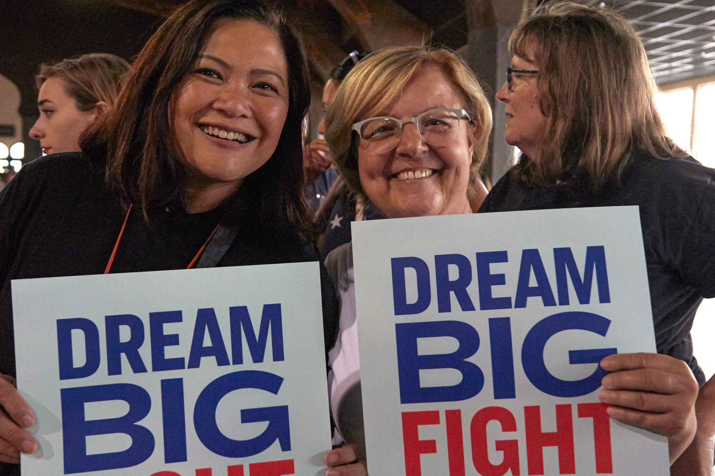 Mimi Roces (left), and Carolyn Casavan, of Long Beach, California, hold signs before a Town Hall event for Elizabeth Warren's presidential campaign, at the Shrine Expo Hall, Los Angeles, California, on August 21st 2019. (Marco Pallotti/The Corsair)