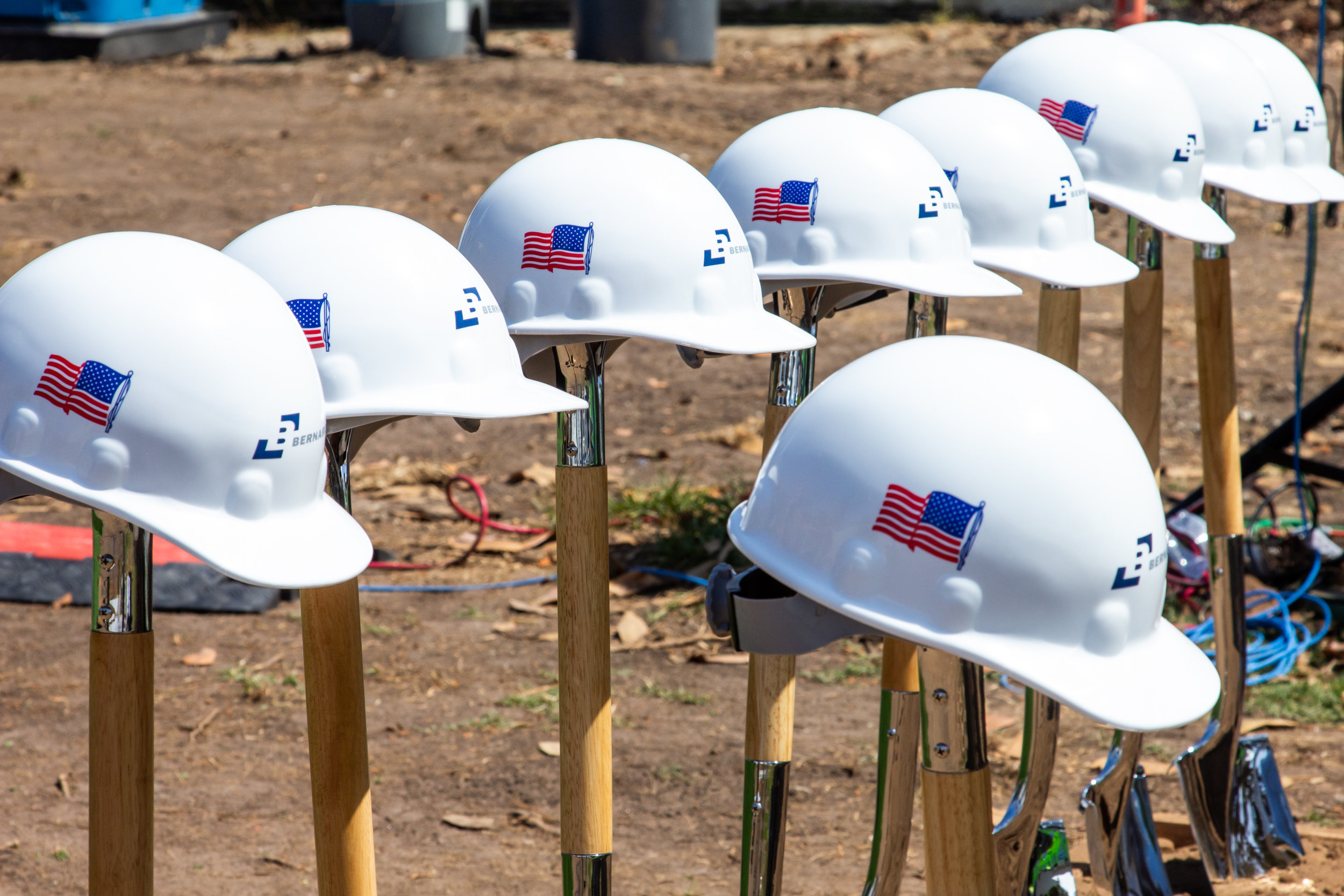 Hard hats sit on shovels in preparation for the groundbreaking ceremony for the John Adams Middle School Performing Arts Complex in Santa Monica, California, on Wednesday, August 28th, 2019. (Marco Pallotti/ The Corsair)