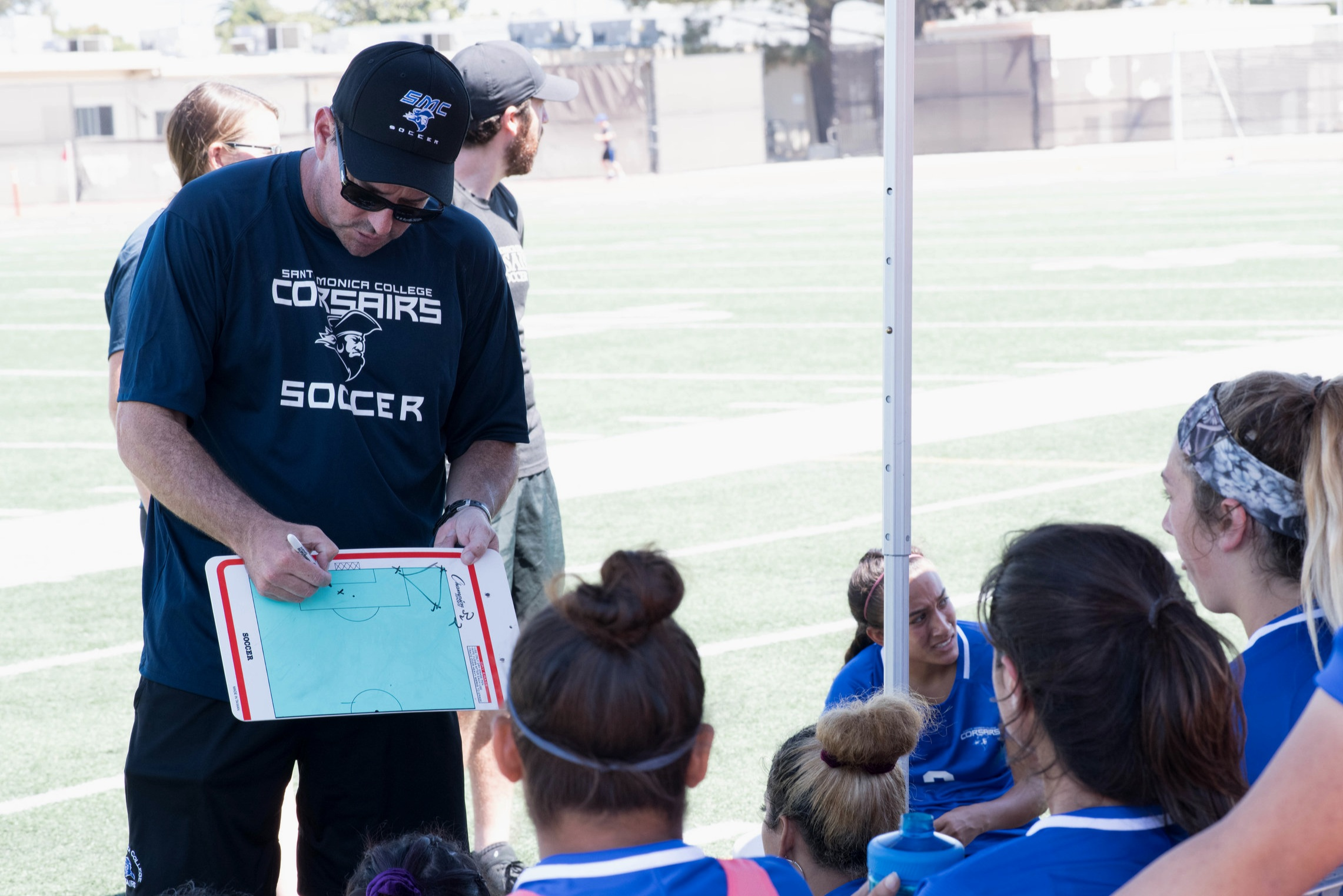 Head Coach Aaron Benditson showing his team the game plan.(Photo By Kevin Tidmore/Caption By Deshawn Pouper/The Corsair)