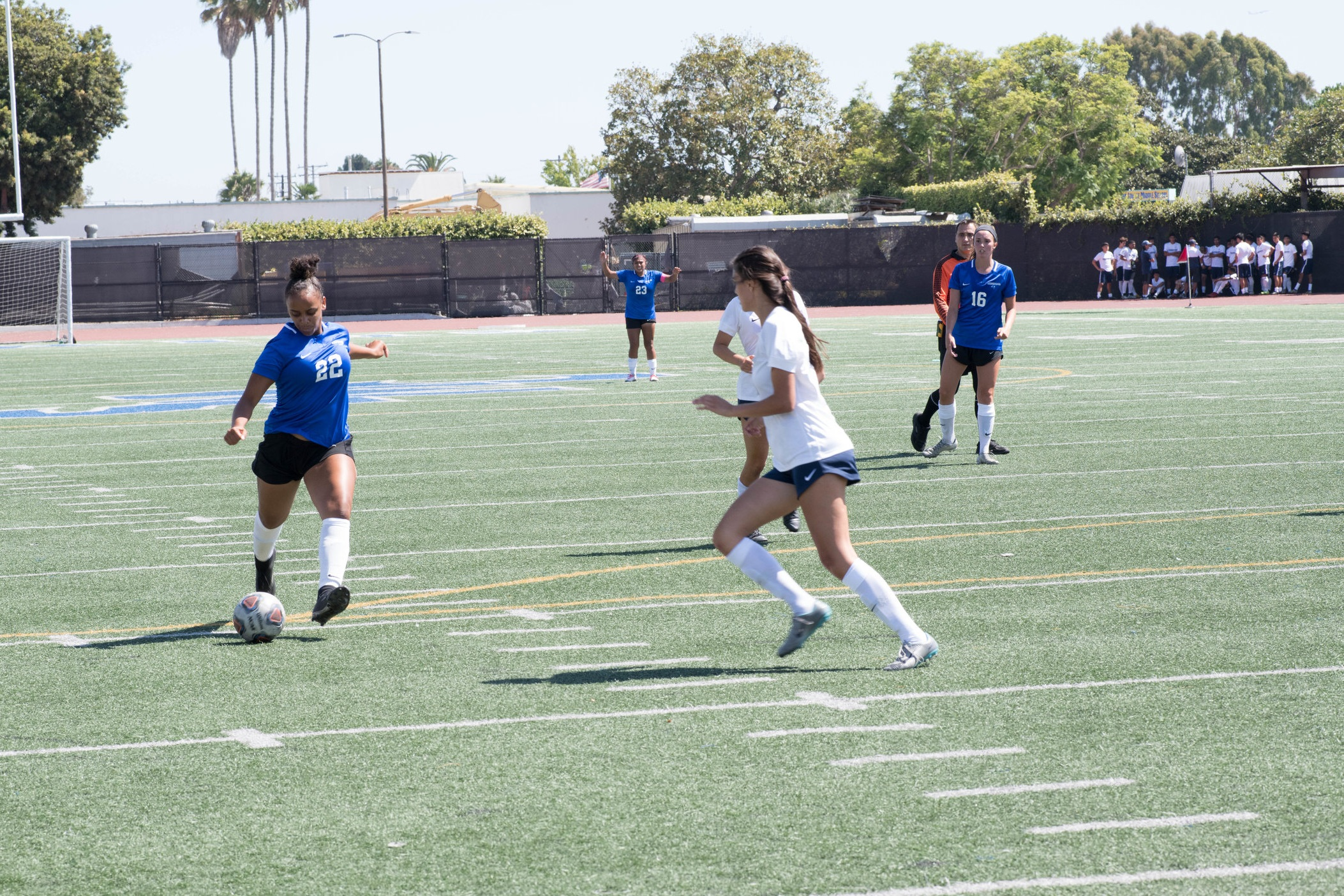 Two El Camino players closing in on Kayla Makkar #22.(Photo By Kevin Tidmore/Caption By Deshawn Pouper/The Corsair)