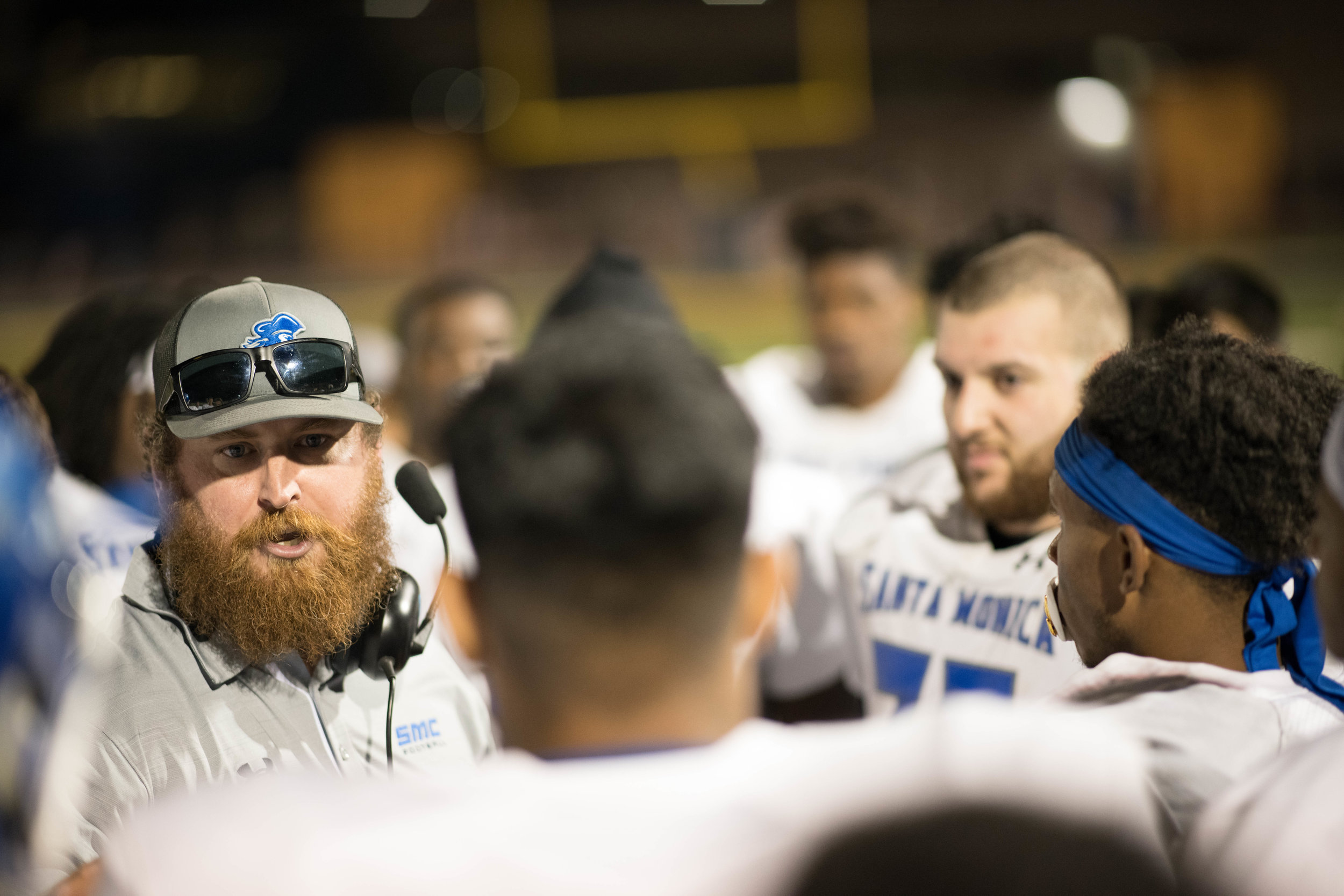 Head Coach Kelly Ledwith speaks to his team at halftime as they get ready for the third quarter.(Photo by Kevin Tidmore/The Corsair)