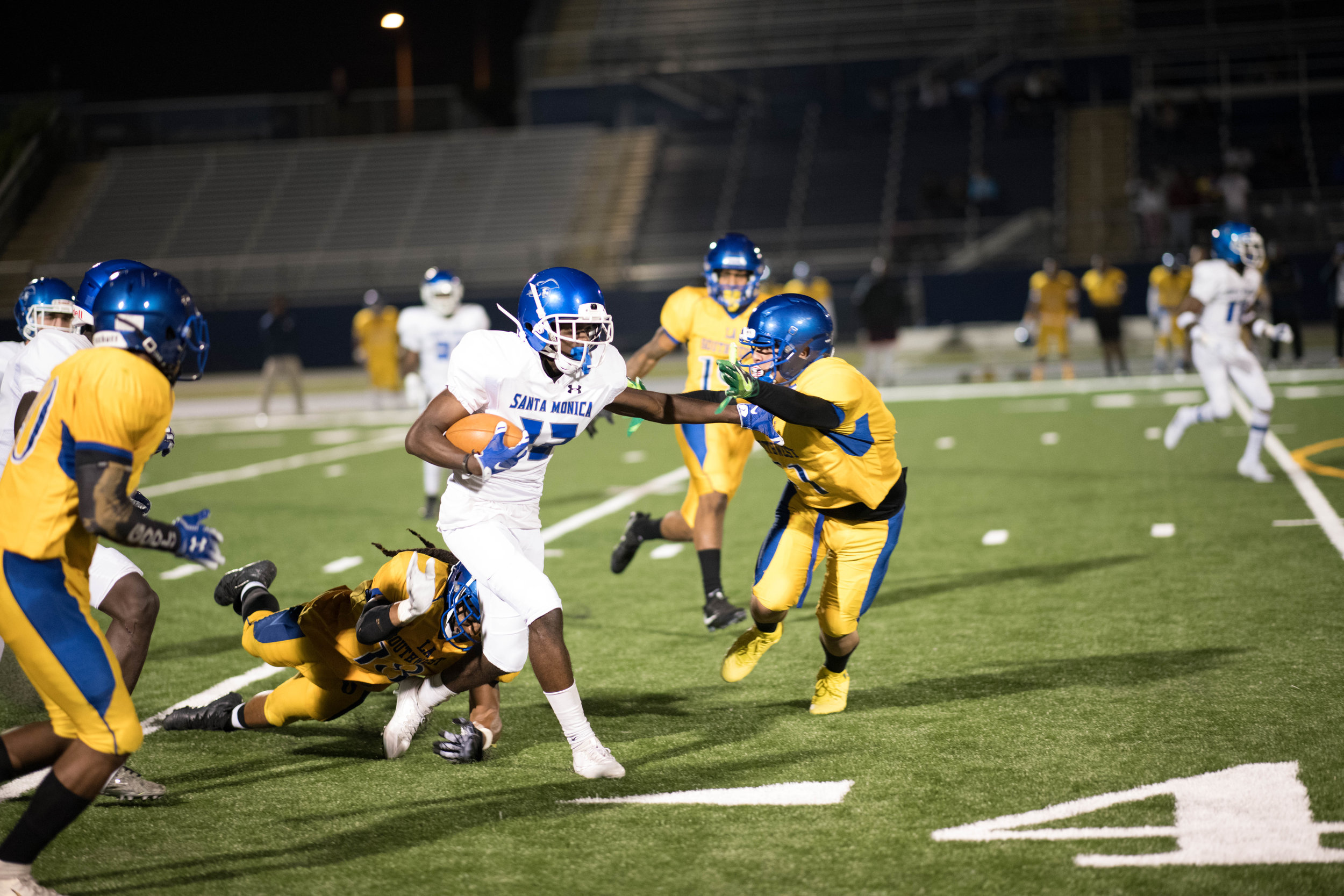 #13 Tariq Brown fights off Southwest defenders as he tries to gain yards.(Photo by Kevin Tidmore/The Corsair)