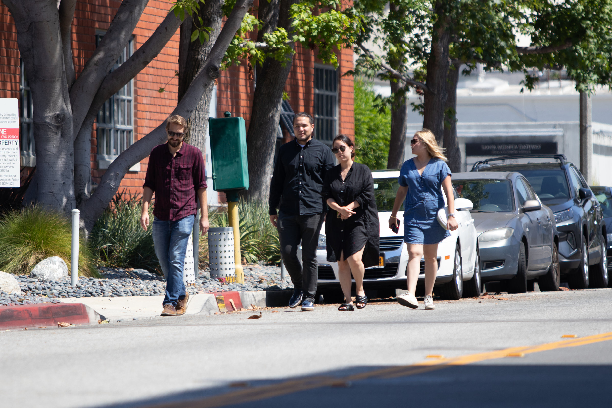 A group of four walking in a car lane on their way to get food from food trucks in Santa Monica, California on September 5th, 2019. (Fernando Duran/The Corsair)