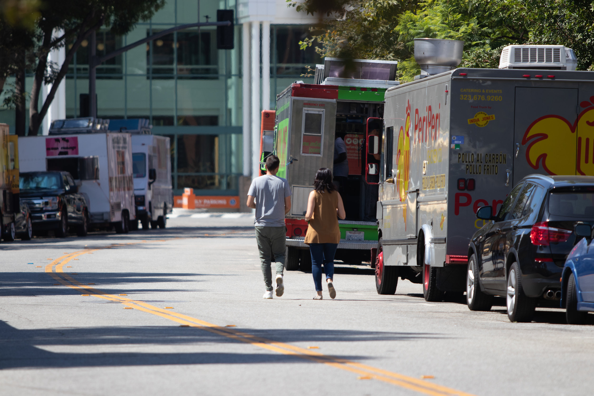 A couple walking in a car lane on the way to get food from a foodtruck. Santa Monica, California. September 5th, 2019 (Fernando Duran/The Corsair)