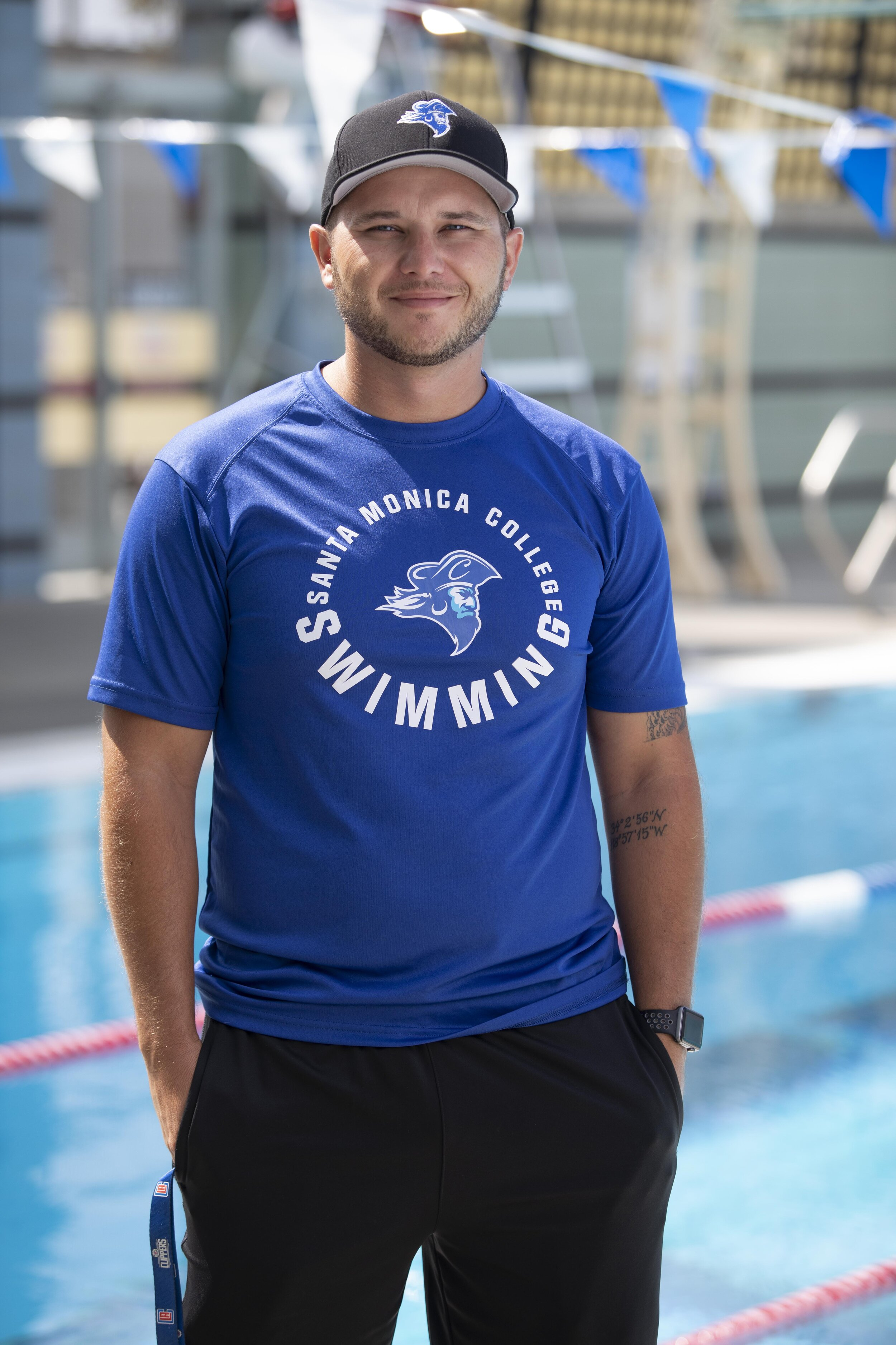 The womens water polo head coach Brian Eskridge poses for a photo for The Corsair newspaper at the Santa Monica College Aquatics Center in Santa Monica Calif. (Joshua Nicoloro/The Corsair)