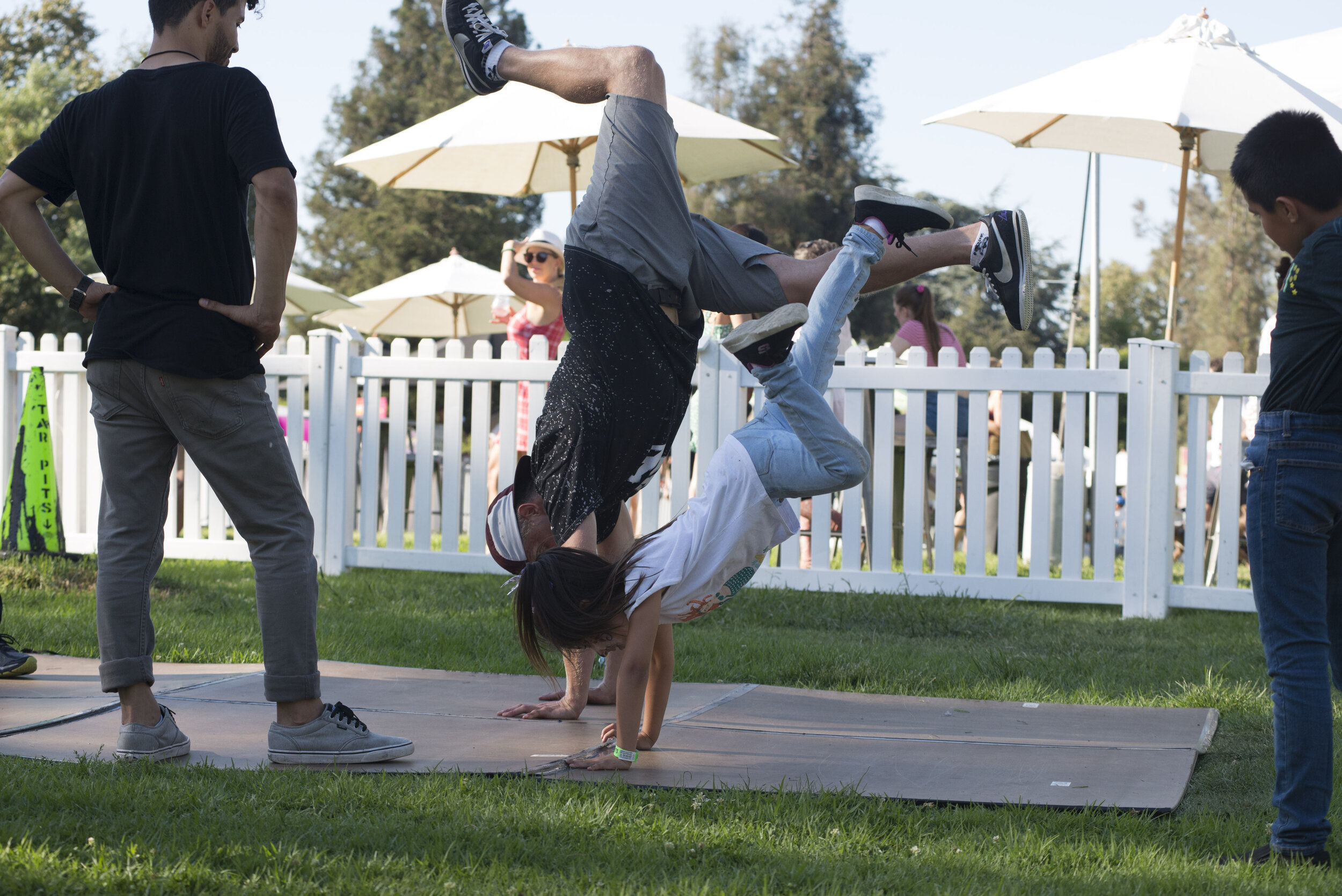 Members from Juice Los Angeles holds a breakdance demonstration for adults and children at Tarfest on September 14, 2019.  (Anthony Mayan/The Corsair).
