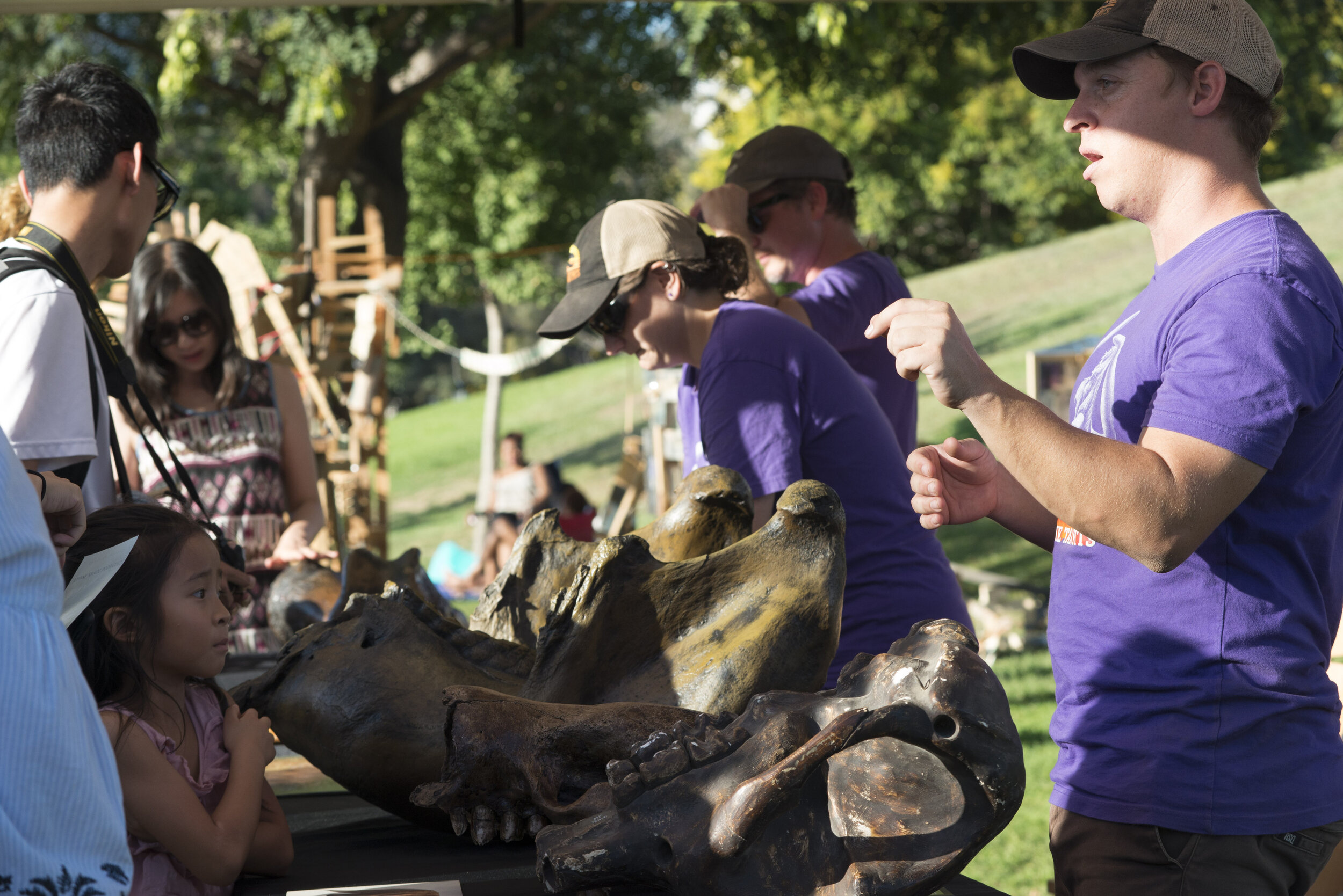 A staff member from the LA Tar Pits Excavation Team showcases various fossil replicas found locally to curious visitors at Tarfest on September 14, 2019.  (Anthony Mayan/The Corsair).