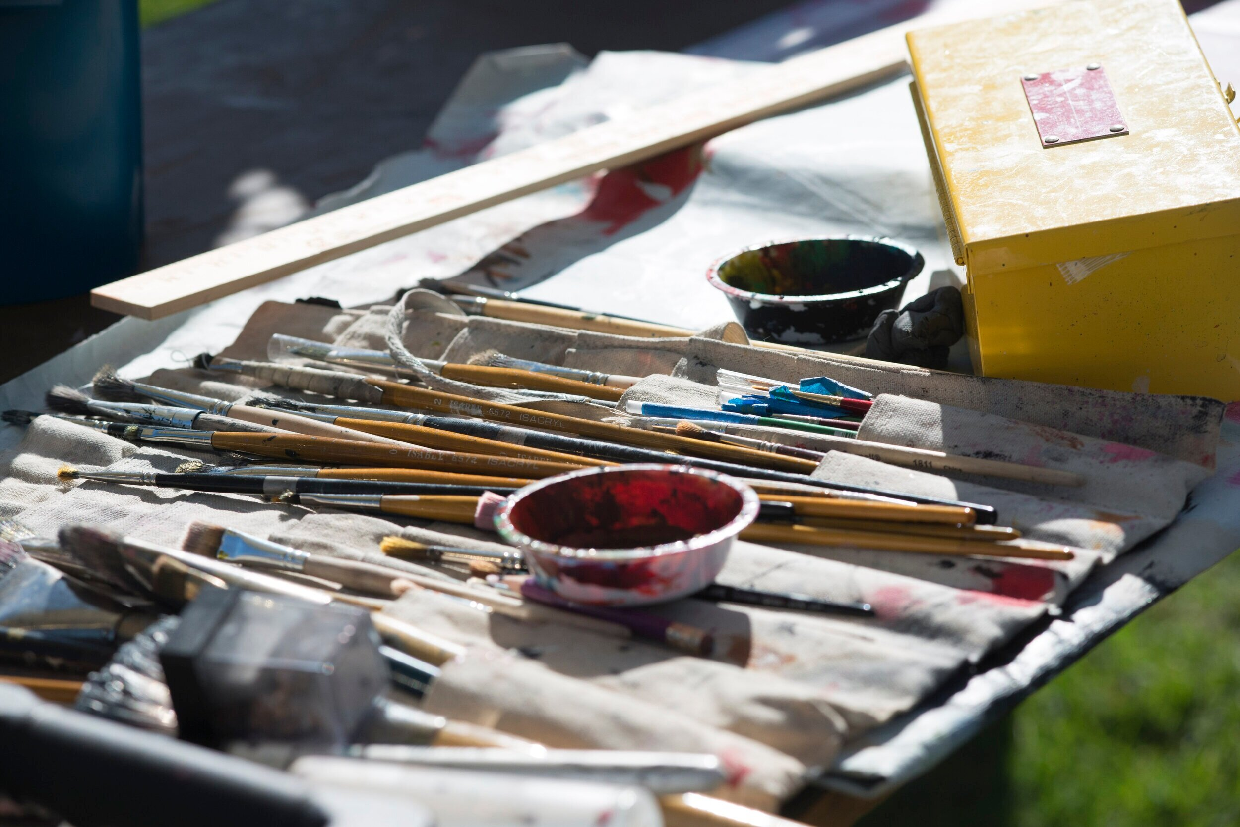 """A collection of various brushes and art tools used by Johnny """"KMND"""" Rodriguez's live painting session at Tarfest.  (Anthony Mayan/The Corsair)."""