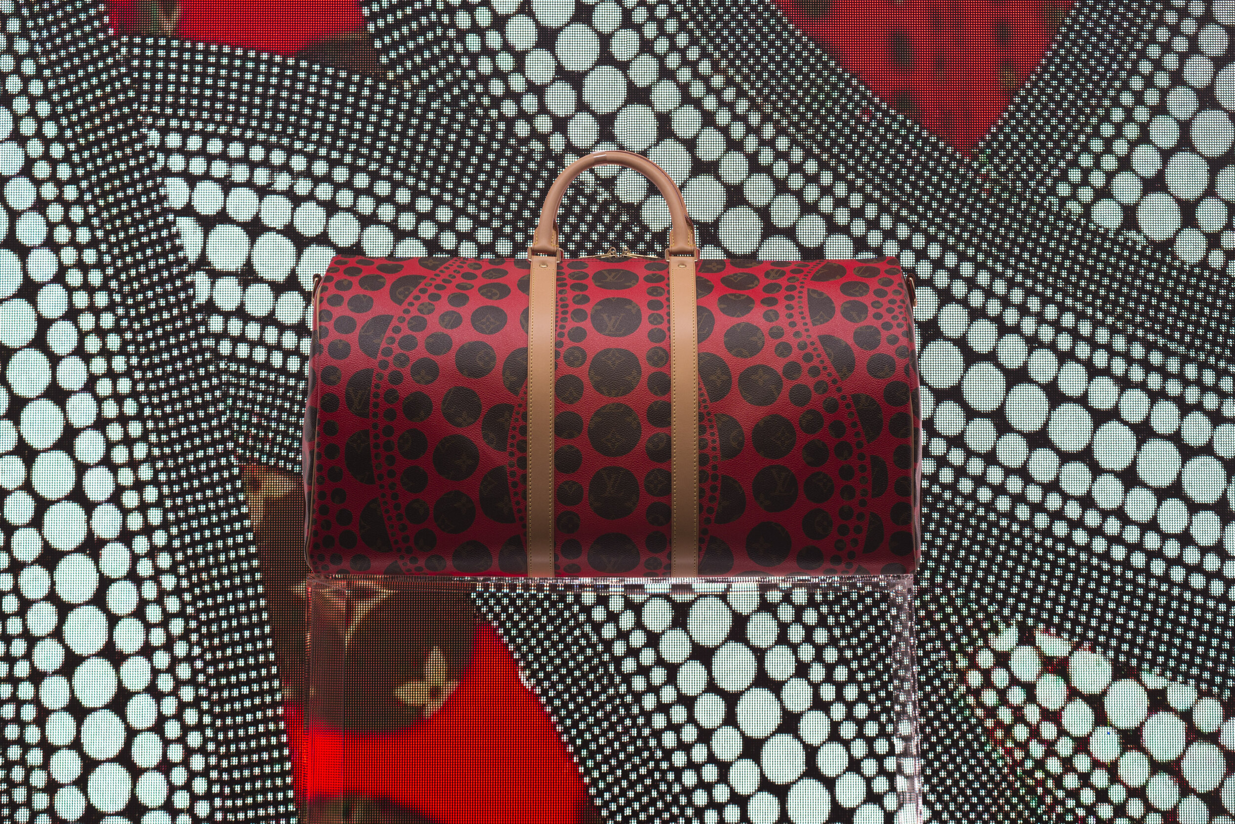Louis Vuitton collaborated with Japanese artist Yayoi Kusama to create this one of a kind designer Keepall bag. Yayoi Kusama is well-known for her eccentric dots in her artwork due to her symptoms from bipolar disorder.  (Anthony Mayan/The Corsair)