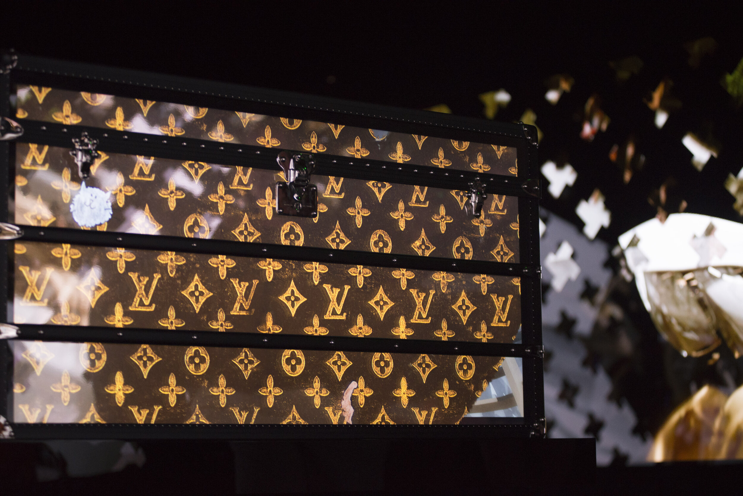 Louis Vuitton created this box to represent Louis Vuitton's history in the form of a Time Capsule. The room itself is completely surrounded by screens playing through Louis Vuitton's history.  (Anthony Mayen/The Corsair) .