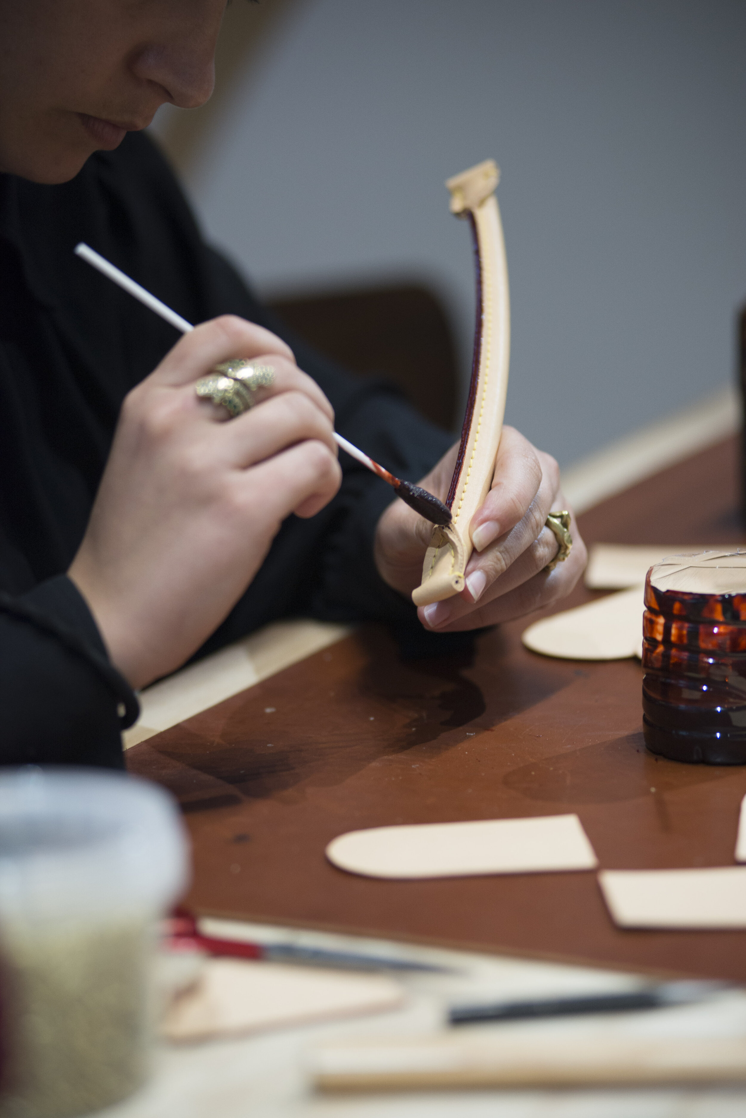 Artisan shows audience the process in making one of Louis Vuitton's bags.  (Anthony Mayen/The Corsair)