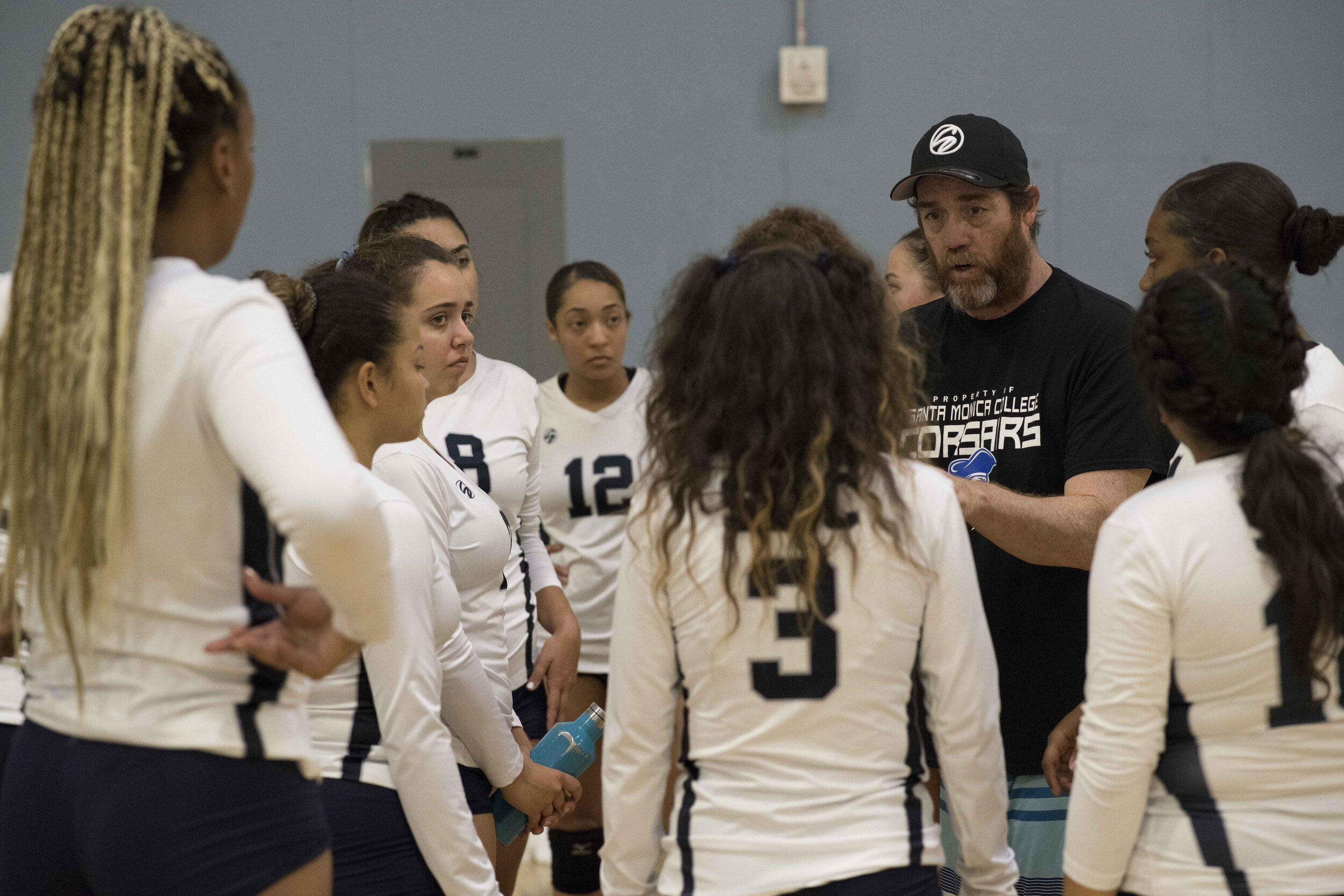 The Corsairs assistant coach taking a moment to talk to the team during a time out. (Photo by Kevin Tidmore/The Corsair)