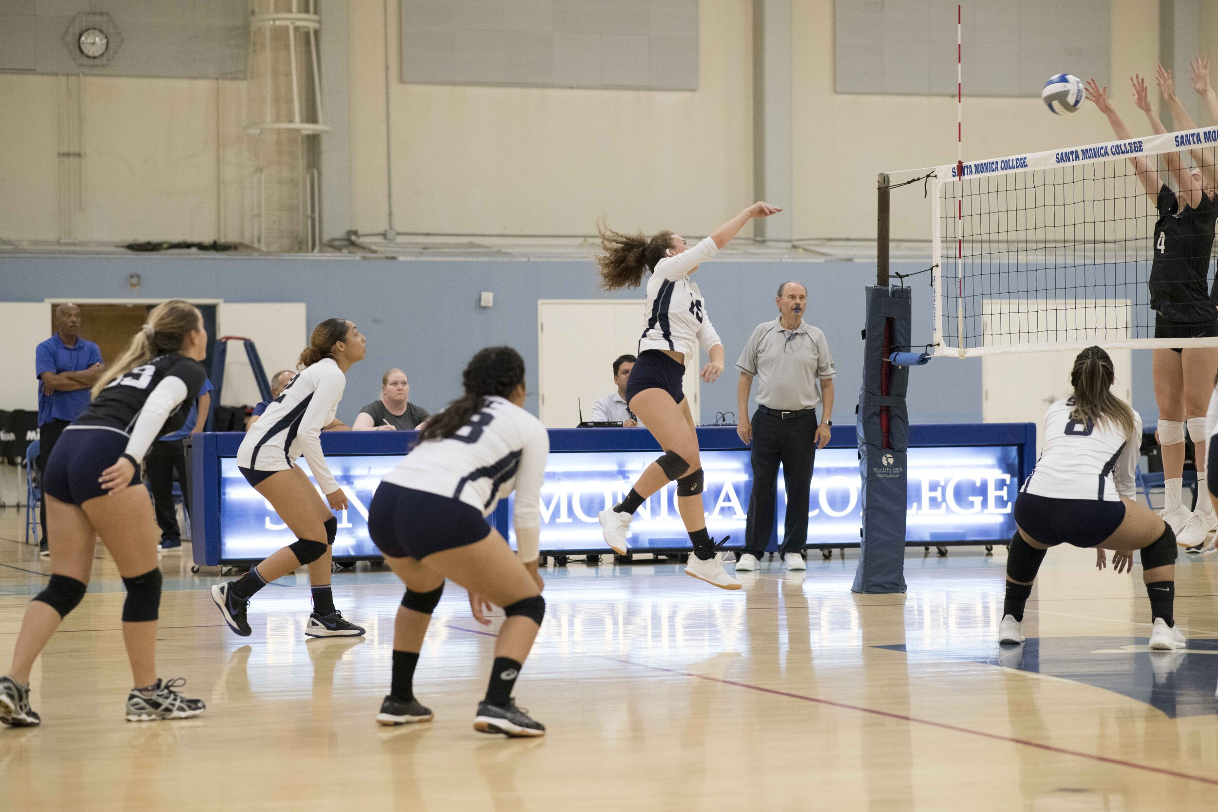 Camila Wilson #15 goes for a kill to help the Corsair's score. (Photo by Kevin Tidmore/The Corsair)