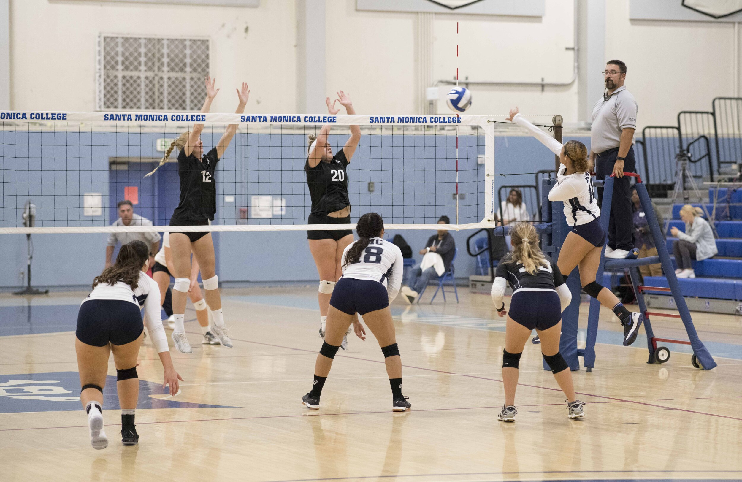 Natalie Crockenberg #12 goes for a kill as two Cuesta players try to block the point. (Kevin Tidmore/The Corsair)