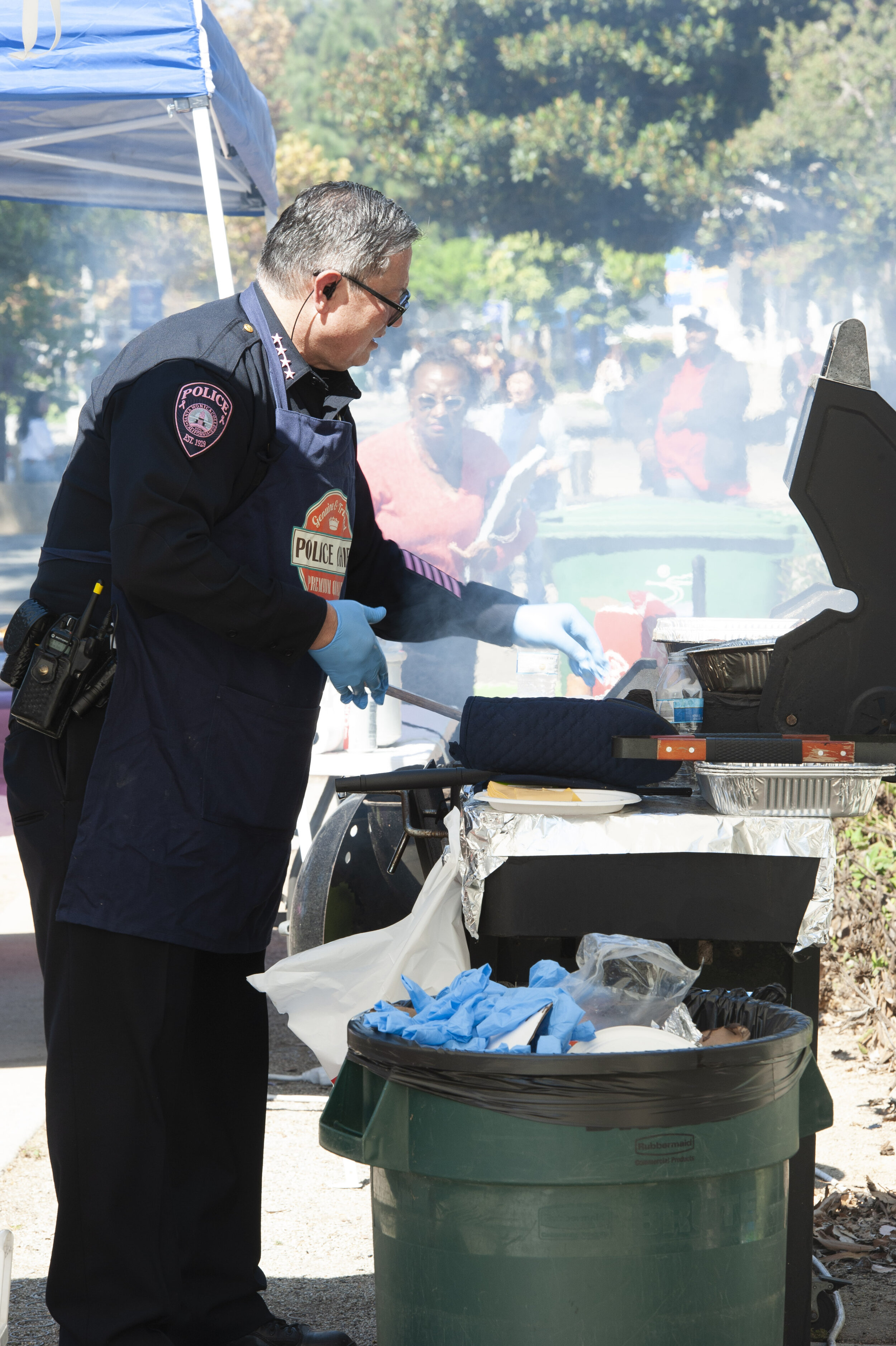 SMC Chief of Police, Johnnie Adams, mans the barbecue on Tuesday, October 8th, 2019, at their headquarters across from Santa Monica College, in Santa Monica, California. All proceeds go to City Of Hope Breast Cancer Research.  (Rachel O'Brien/The Corsair)
