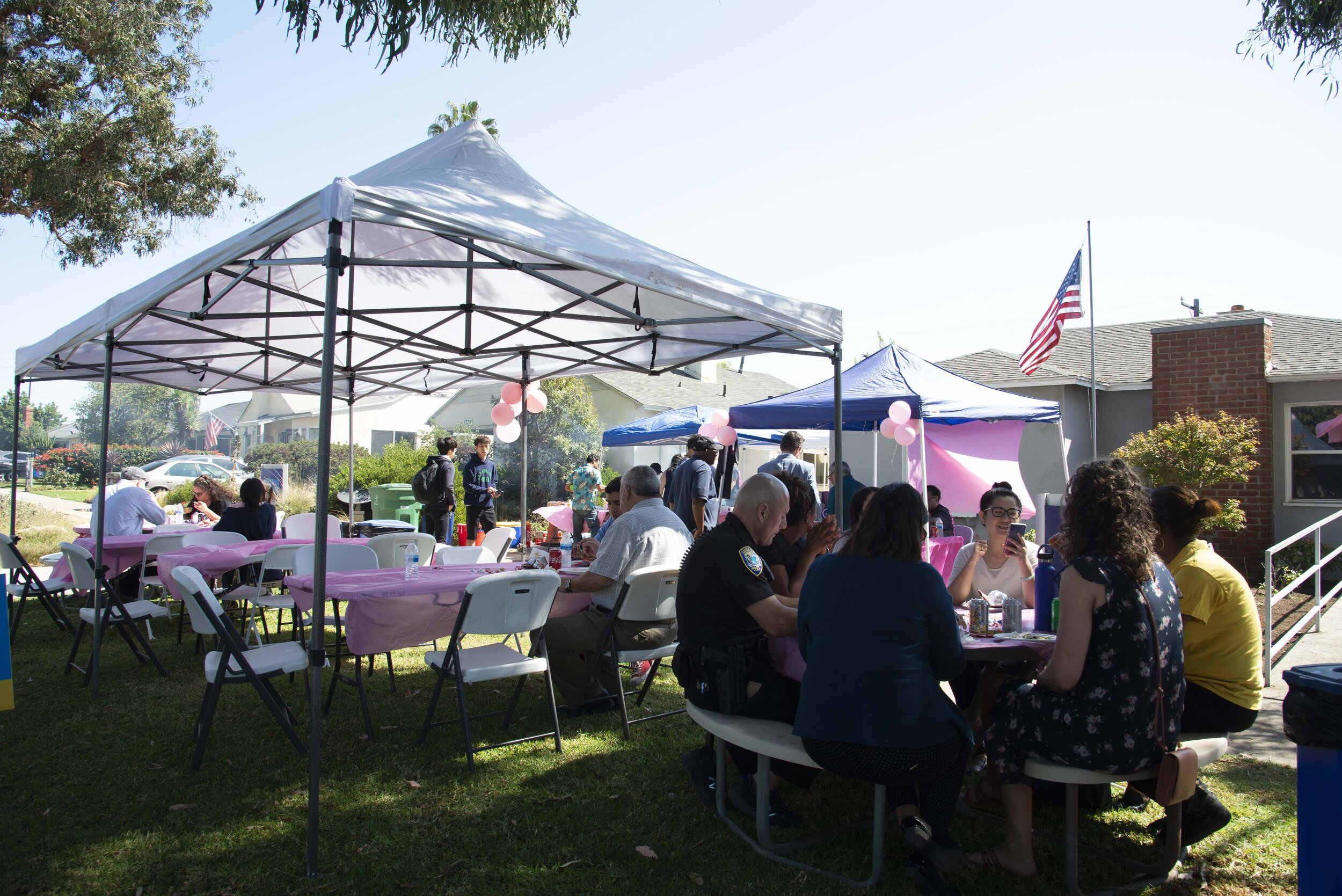 Tables and grills filled the grassy lawn outside of the SMC Police Department's campus headquarters in spirit of their fundraiser.  (Rachel O'Brien/The Corsair)