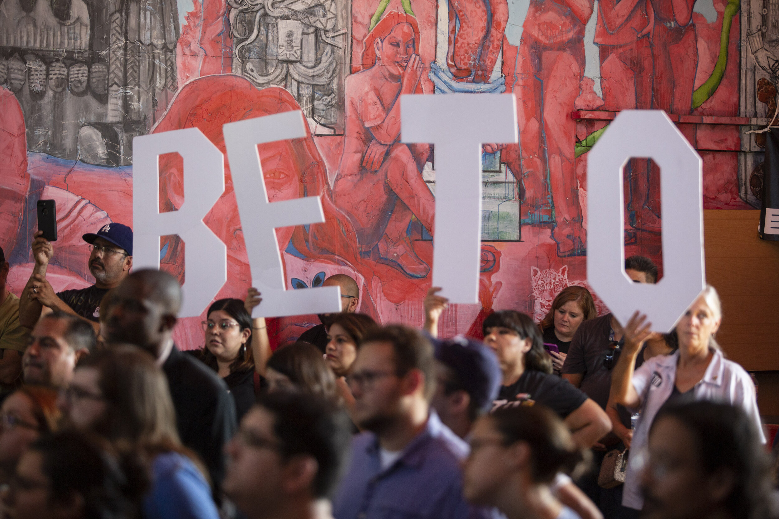 Beto O'Rourke's supporters, holding signs, during a town hall event at Casa del Mexicano, on Saturday, October 5, in Los Angeles, Calif.  (Yasamin Jtehrani / The Corsair)