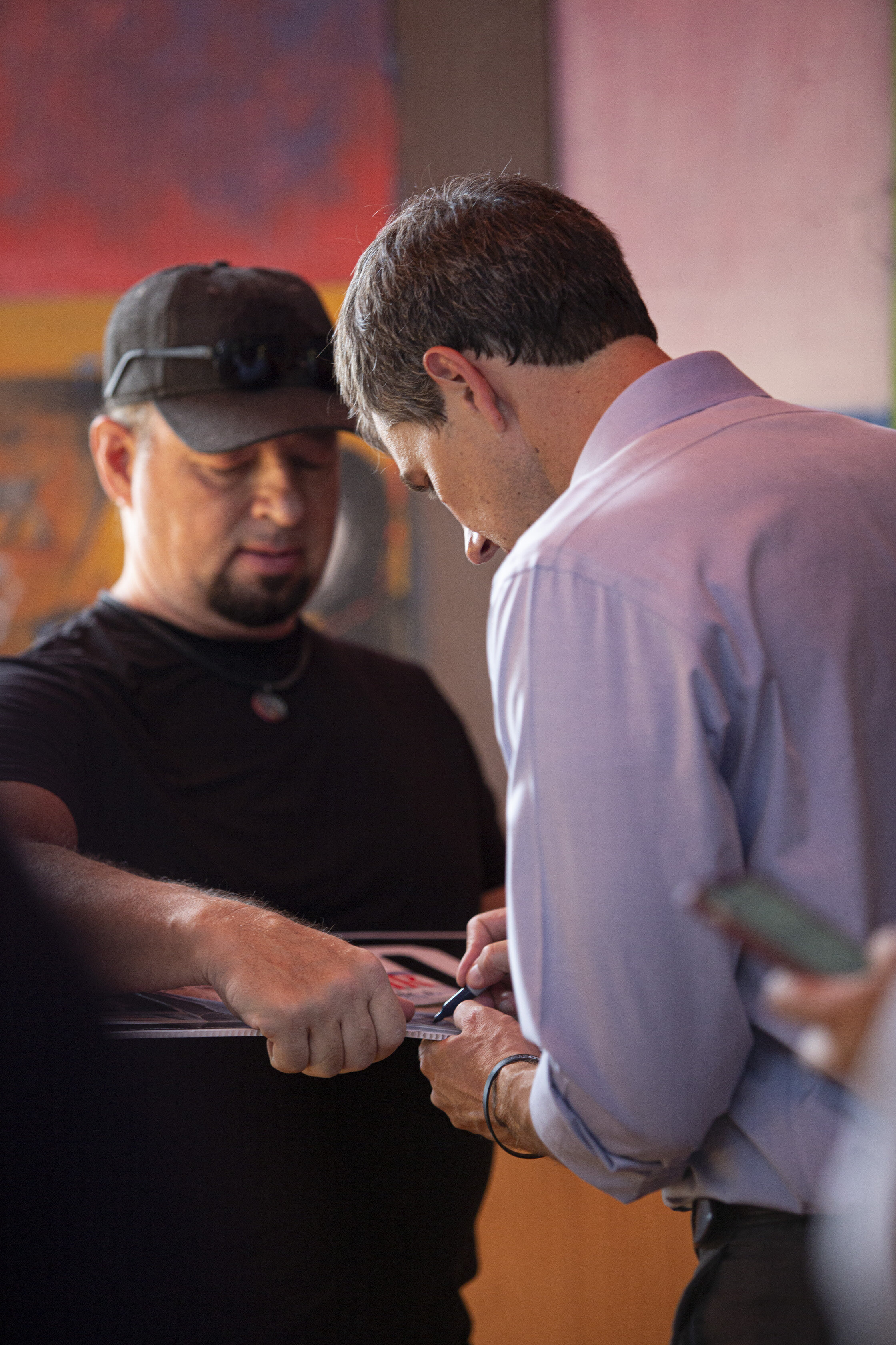 Democratic Presidential Candidate Beto O'Rourke signing a picture of himself for a supporter at the end of the town hall event at Casa del Mexicano, on Saturday, October 5, in Los Angeles, Calif. (Yasamin Jtehrani / The Corsair)