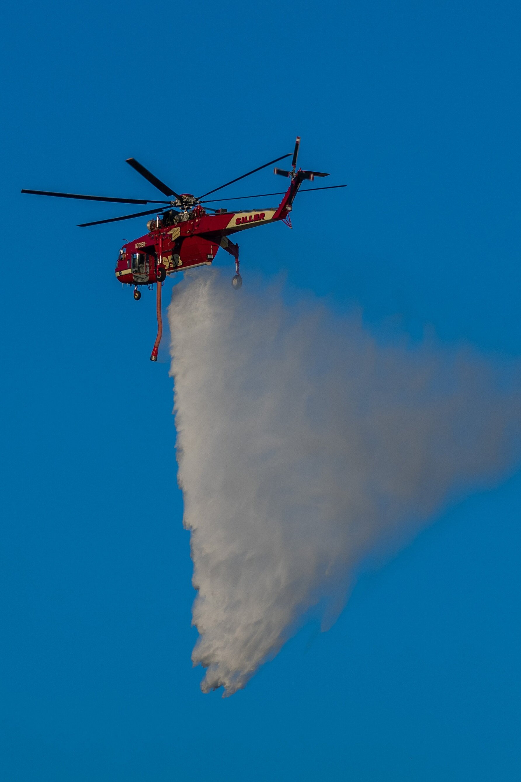 A helitanker dropping water on a part of the Saddlerige Fire near Newhall Calif. on Friday, Oct. 11, 2019. (Conner Savage/The Corsair)