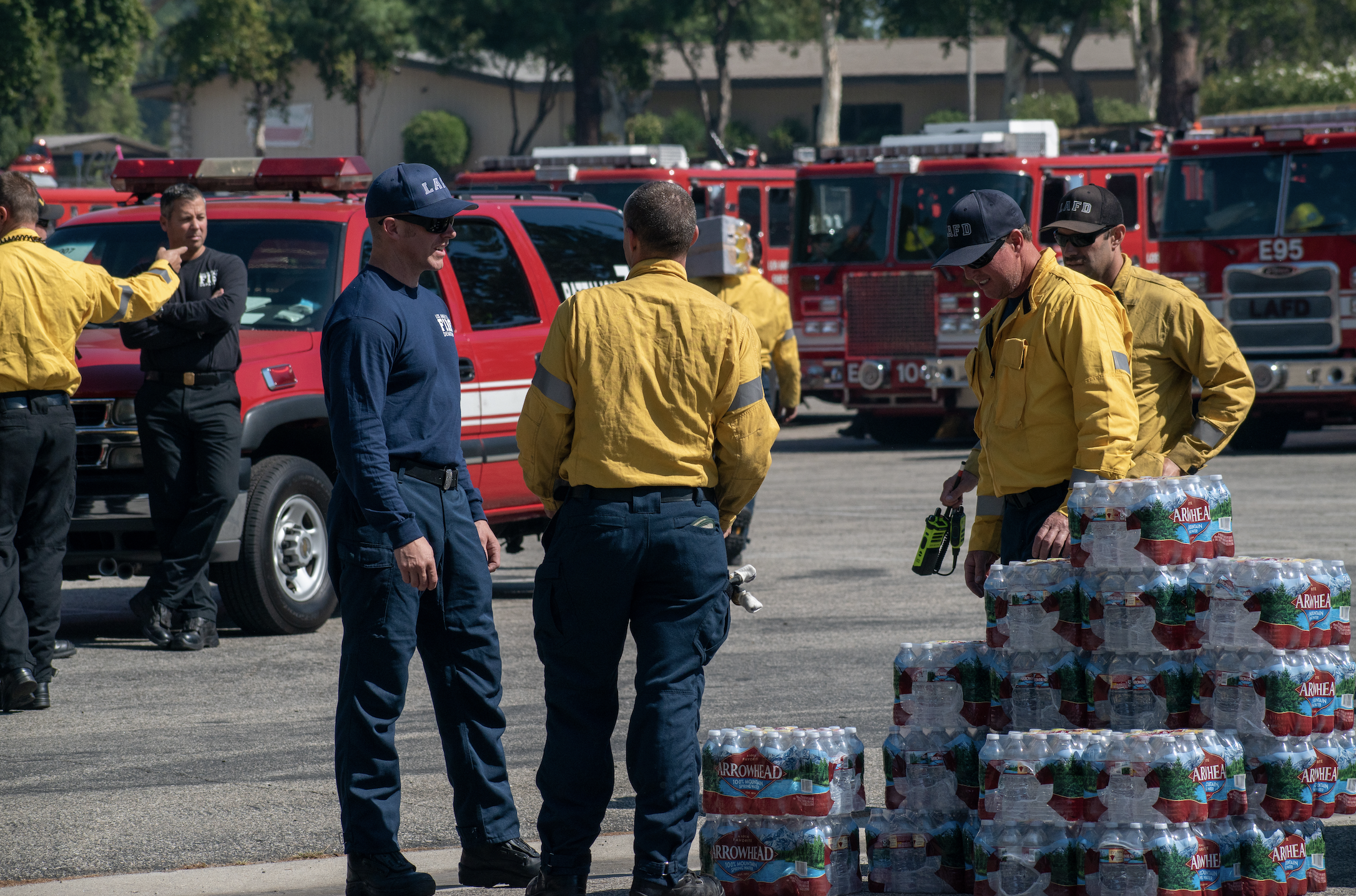 Los Angeles and Riverside Fire Department officials gather with food, water and other resources before heading into the Saddleridge fire on Friday, Oct. 11, 2019 in Porter Rach, Calif. (Randy Martinez/The Corsair)