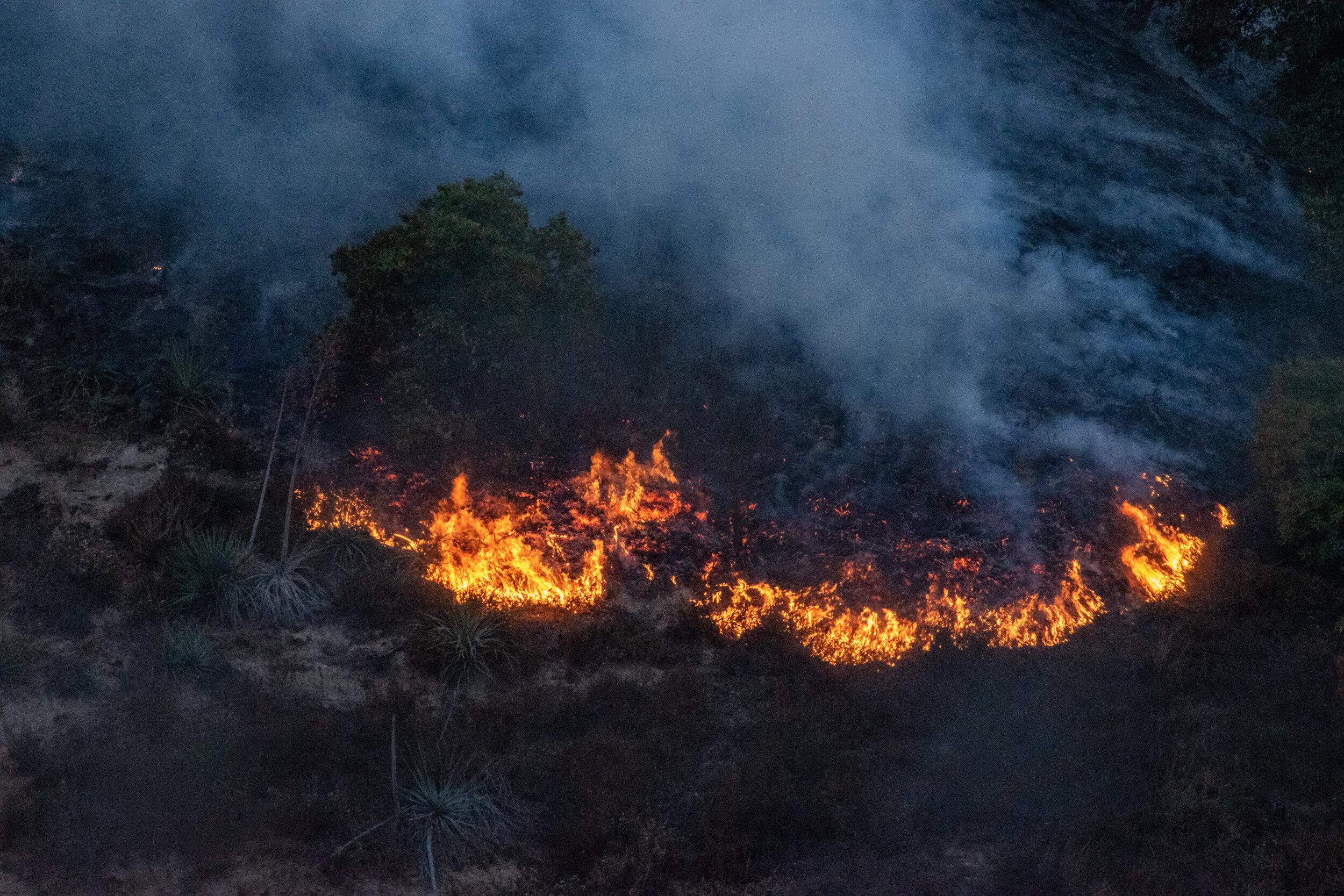 A hillside fire blazes beside the South I-5 freeway just north of Sylmar, Calif. on Friday, Oct. 11, 2019 as the Saddleridge Fire burns through the San Fernando Valley. (Randy Martinez/The Corsair)