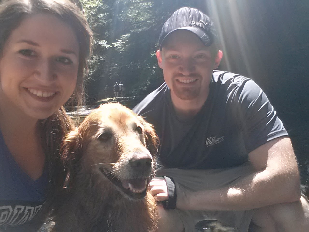 Me, Lily, my dog, and Brandon, my boyfriend, on our first hiking date in 2014.