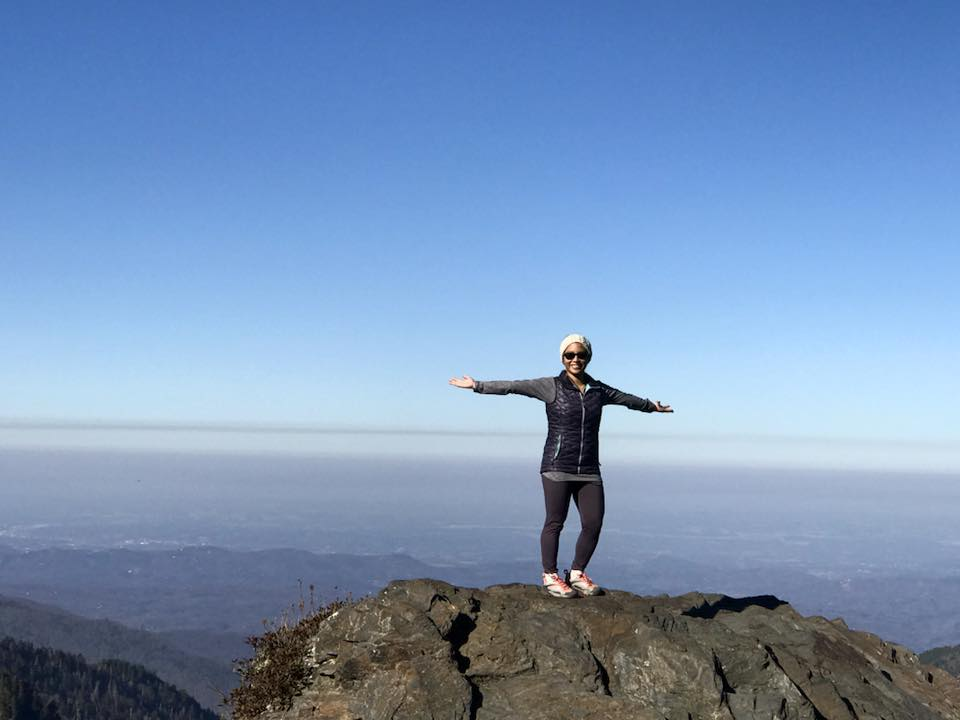 a typical fall hiking outfit of a thin pullover, light puffy vest, and headband– Charlie's Bunion in the Smoky Mountains