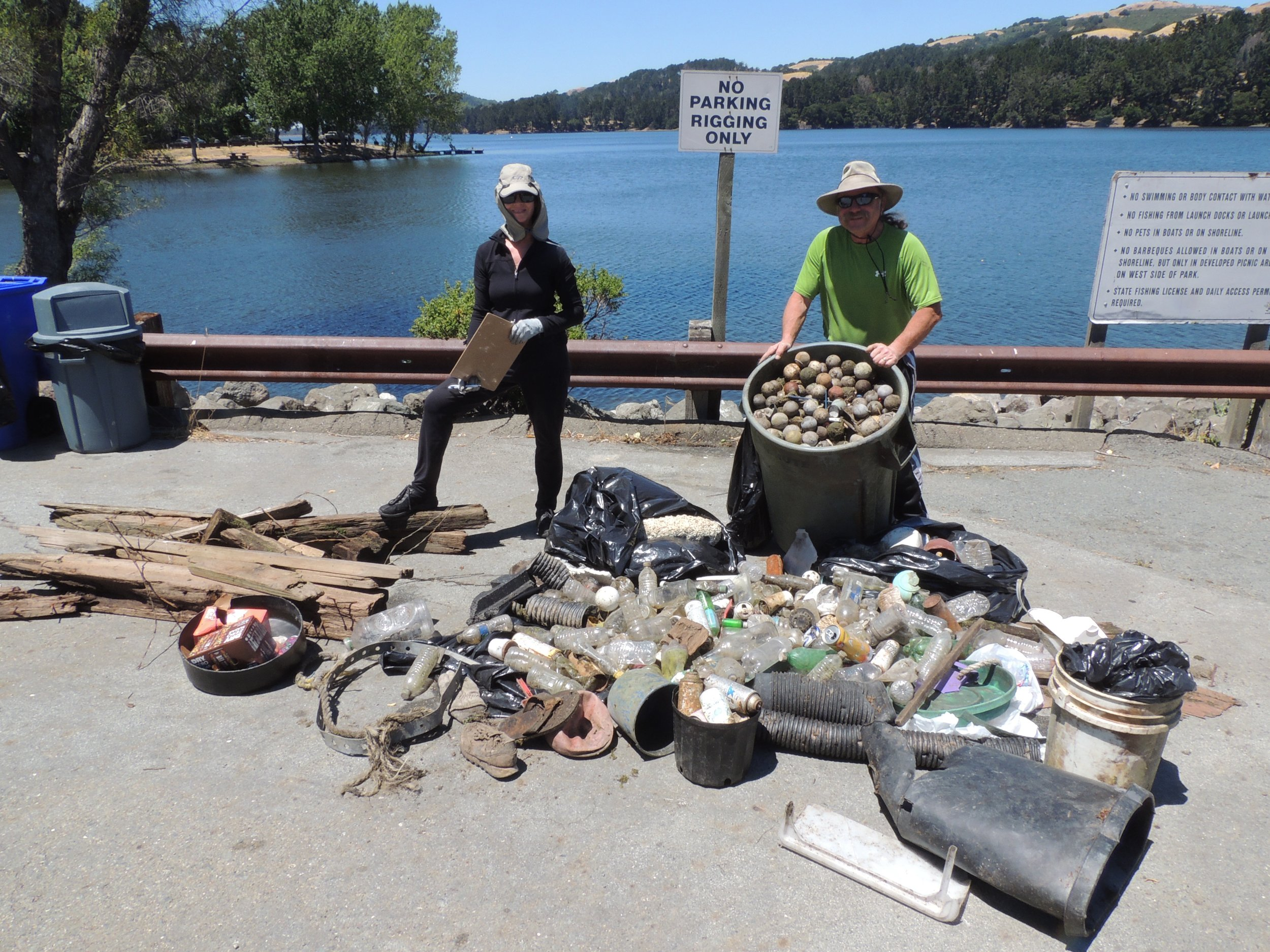 C4AGES Coordinator Sharon Korotkin & event leader Ken Chainey pose with the trash collected at Third Annual Kayak Clean-up (6/23/18)
