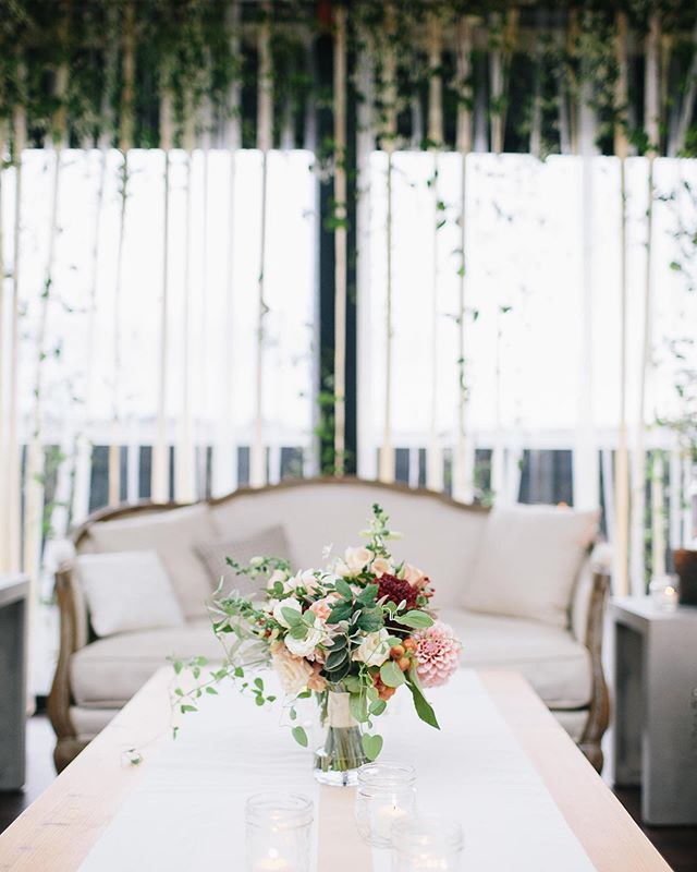 Doesn't take elaborate decor to set an ambiance.  @rentedelegancedesign and @botanique_flowers_seattle transformed the already jaw dropping beautiful @olympicrooftoppavilion for Brandon and Jeana's wedding.  Jeana wanted airy, soft, romantic, organic and special. Dream achieved. . Getting ready for another wedding there this weekend.  Once of my fave spaces.  Gorgeous overload. . . See more pics from this stunner in my stories.  Pc: @erinnjhale  #olympicrooftoppavilion #seattleweddings #seattleweddingplanners #softseating #weddinglounge #weddingbackdrop