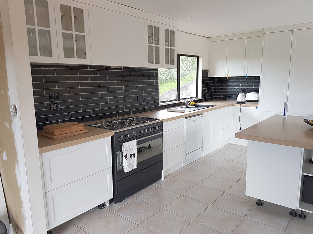 ~Kitchen project with new floor tiles and black contrasting splash-back
