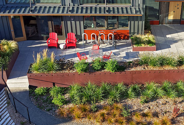 The  Greenfire Campus landscape used drought-tolerant and native plantings to reduce water use, as well as harvesting water in two large cisterns for re-use.