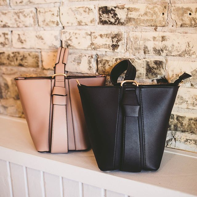 Did you know that we have an entire collection of PETA-approved, vegan leather handbags here in our store? We are proud to say that @meliebianco is one of our best selling designers! With so many cute colors and unique designs being released every season, it'll be hard for you to leave without one!⠀⠀⠀⠀⠀⠀⠀⠀⠀ .⠀⠀⠀⠀⠀⠀⠀⠀⠀ The Scarlet Bucket Bag comes in black and taupe options (pictured here) and has the cutest, centrally located wrist strap, and detachable, matching crossbody strap. Another classic two-in-one handbag? Yes, please! ⠀⠀⠀⠀⠀⠀⠀⠀⠀ .⠀⠀⠀⠀⠀⠀⠀⠀⠀ Swing by today from 10-5 to check out our entire collection! #meliebianco #grandrapids #grandrapidsboutique #easthills #shopgr