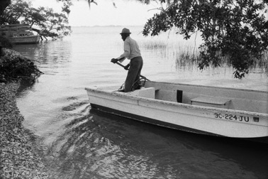 Jake and his Boat Arriving on Daufuskie's Shore , 1978. From Daufuskie Island.Jeanne Moutoussamy-Ashe.